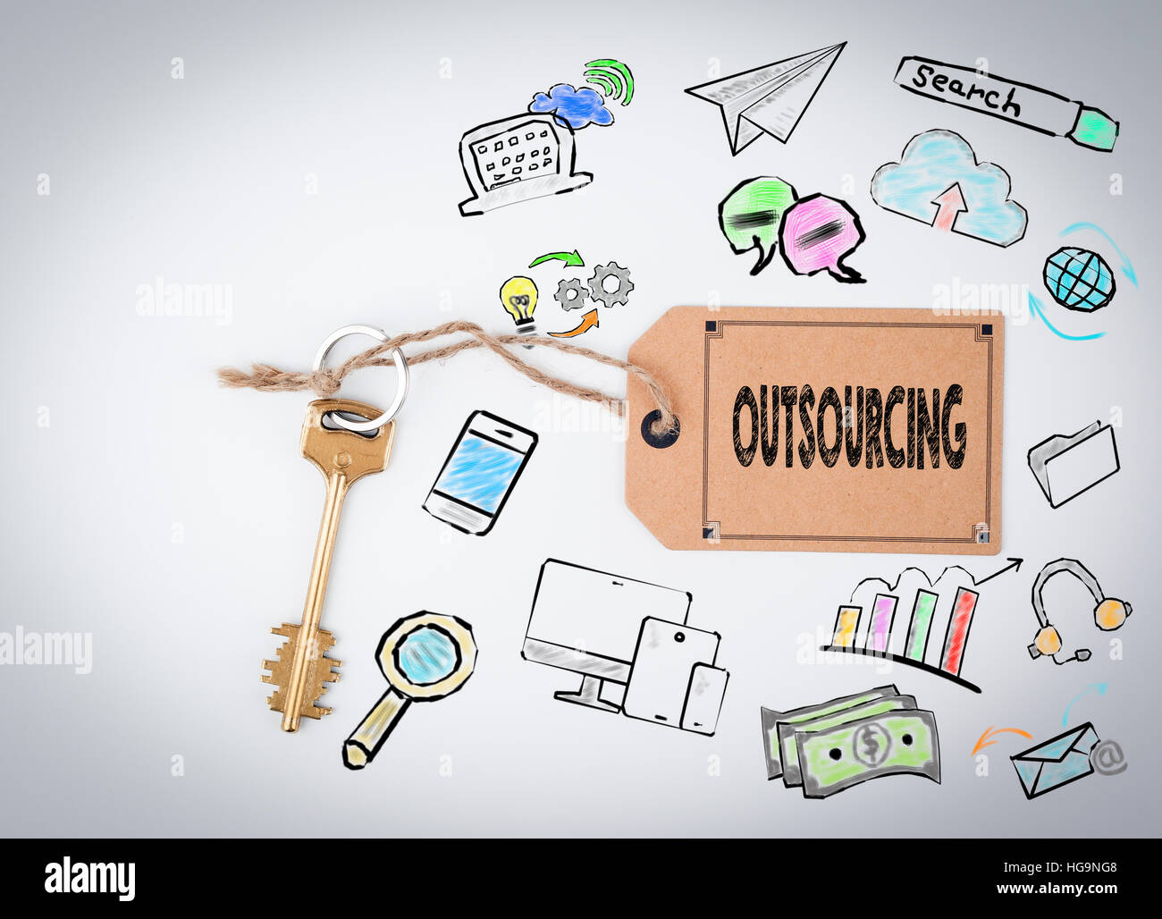 Outsourcing. Key and a note on a white background - Stock Image