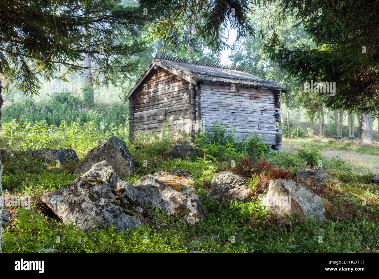 Old Wooden warehouse, barns, sheds in the forest  Stones