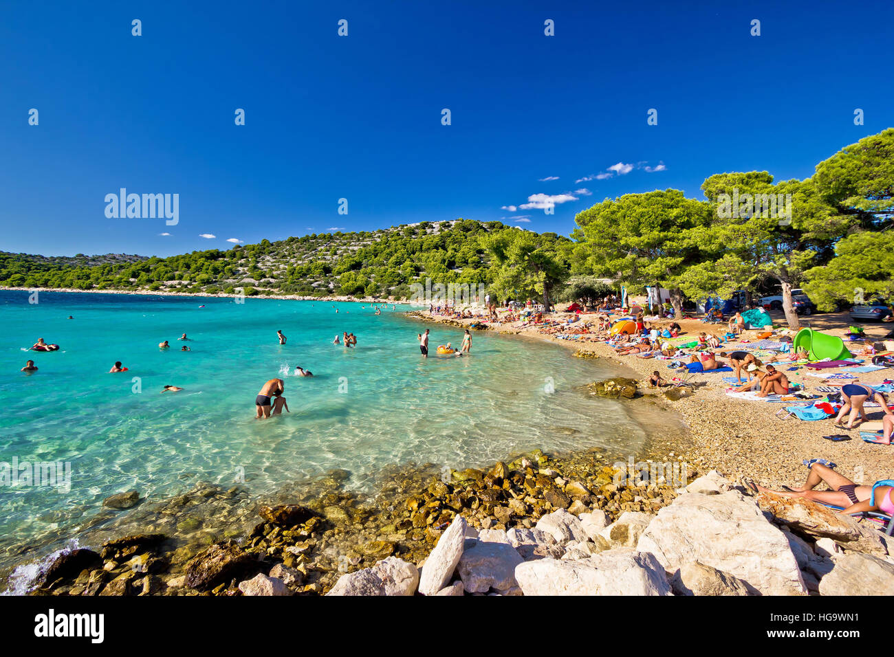 MURTER, CROATIA - AUGUST 17: Unidentified people enjoying summer holldays on crystal clear turquoise beach in Croatia, - Stock Image