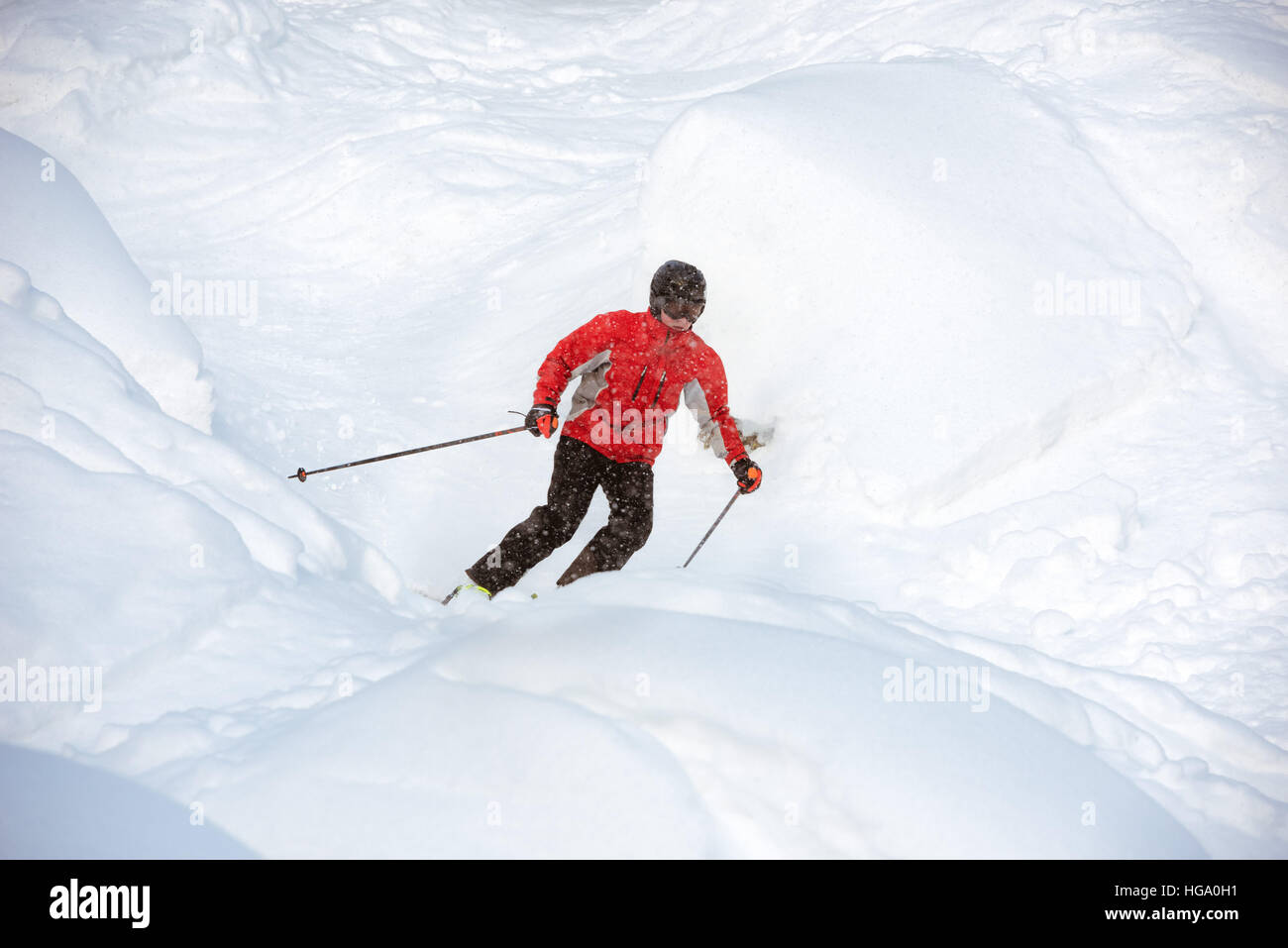 Young skier off-piste backcountry freeride - Stock Image