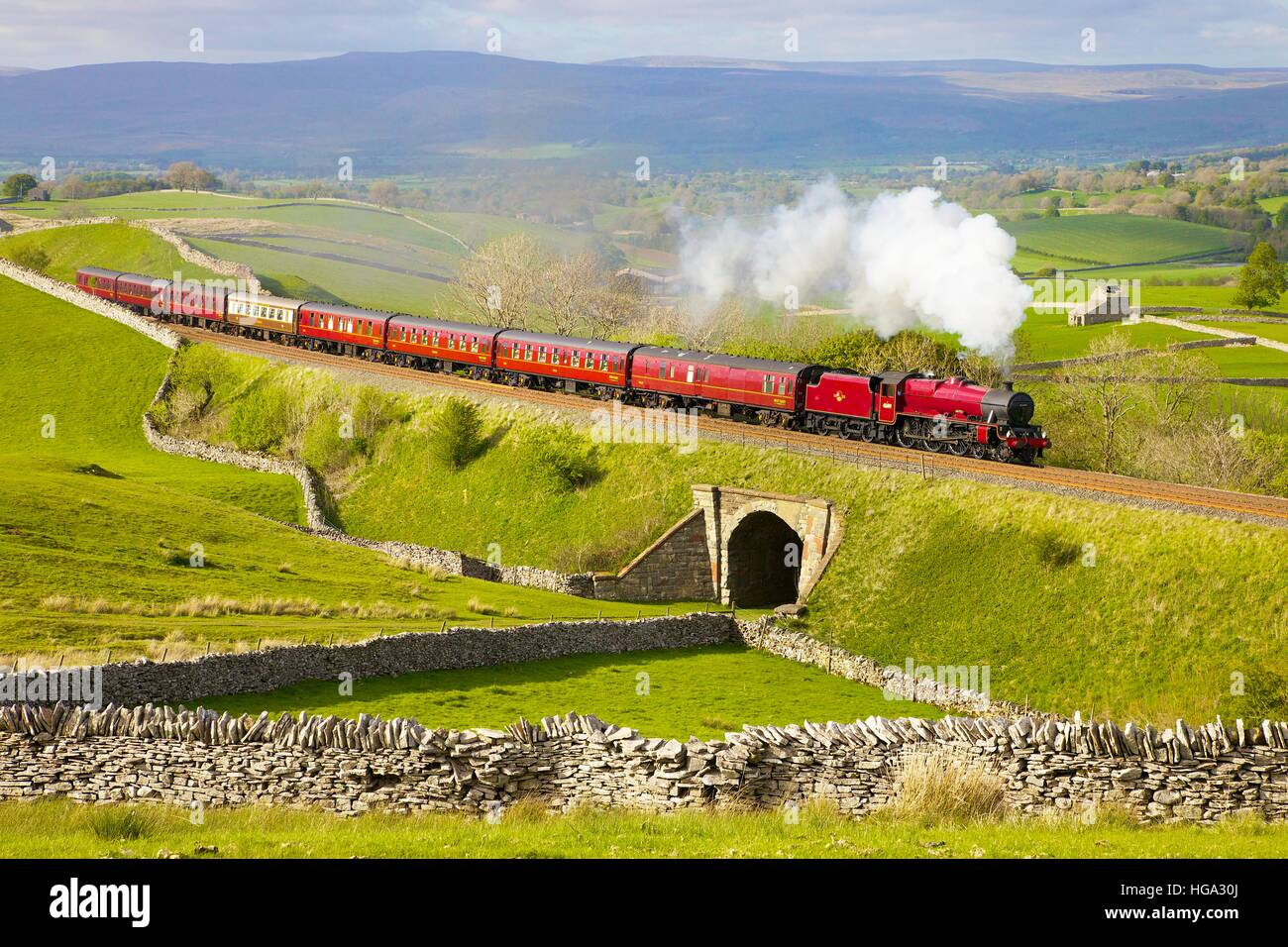 Steam train on the embankment at Greengate. Kirkby Stephen, Settle to Carlisle Railway Line, Eden Valley, Cumbria, - Stock Image