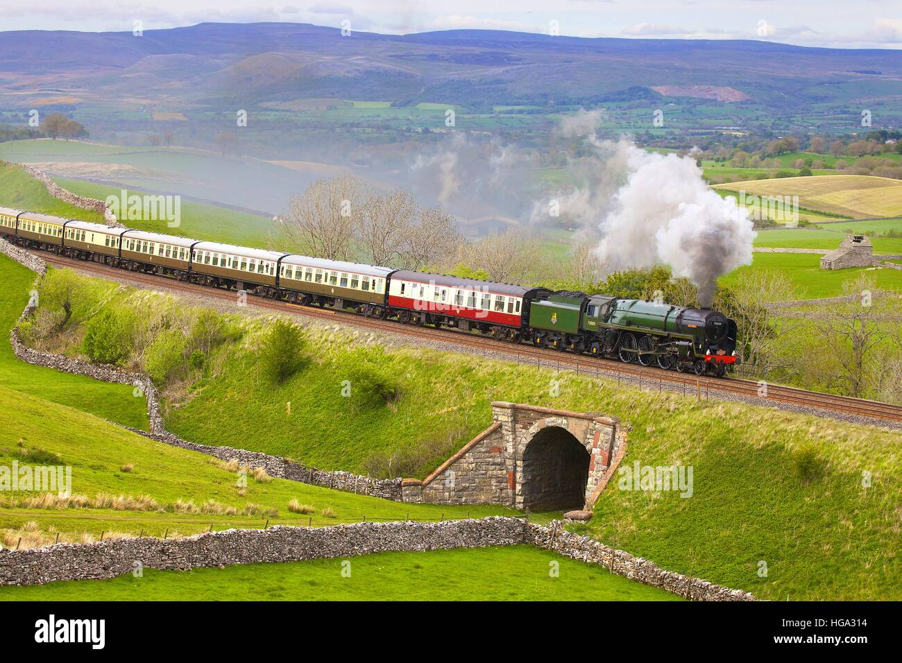 Steam train Britannia on the embankment at Greengate. Kirkby Stephen, Settle to Carlisle Railway Line, Eden Valley, - Stock Image