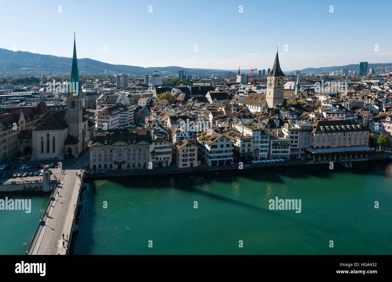 Zurich's old town with Fraumunster cathedral (left) and church St. Peter (right) at the Limmat river, seen from - Stock Image