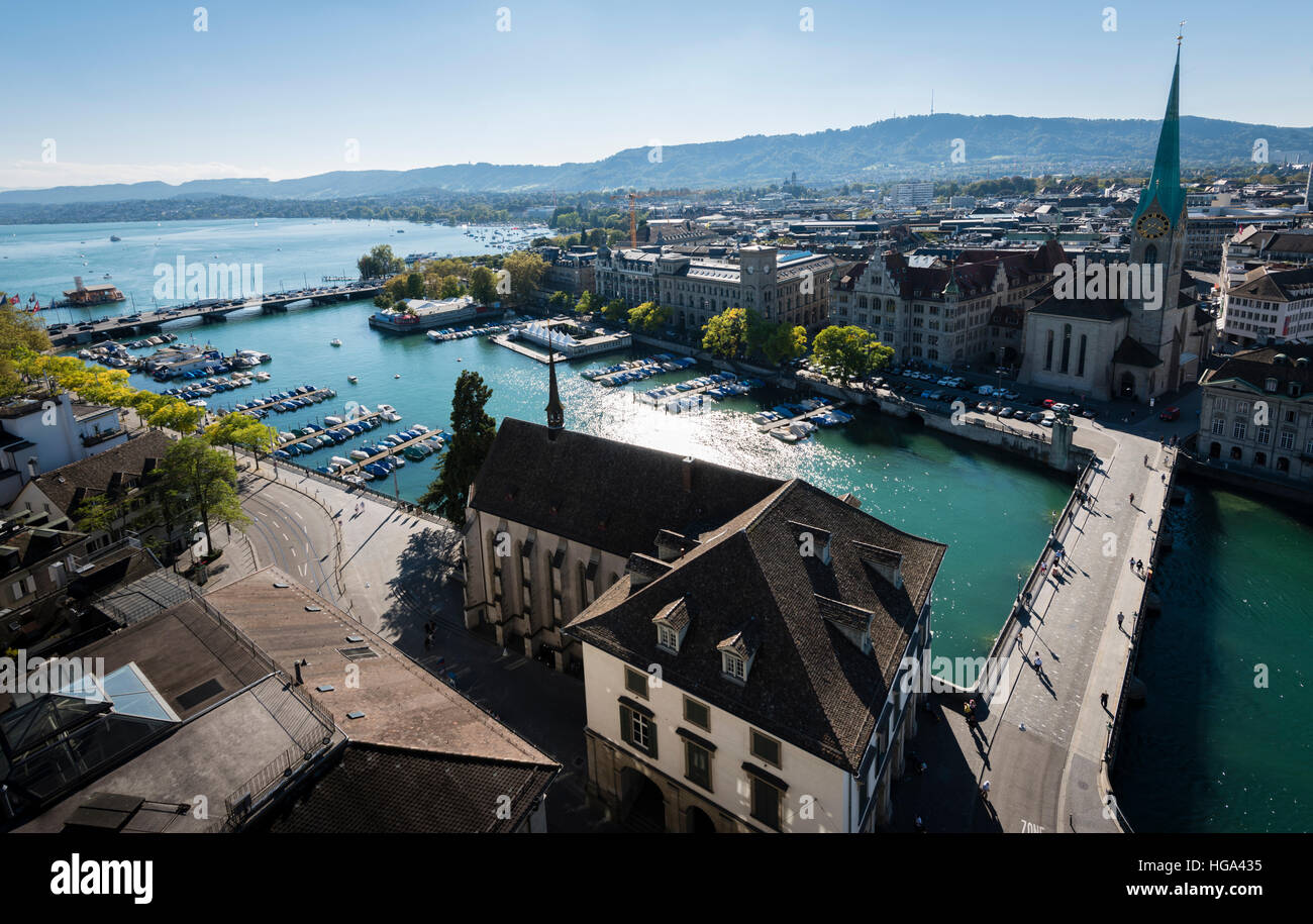 Zurich's old town with Fraumunster cathedral (right) at the Limmat river and lake Zurich, seen from Grossmunster - Stock Image