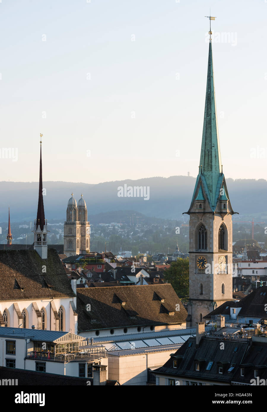 Zurich city panorama with the twin towers of Grossmunster cathedral and Predigerkirche in the setting sun. - Stock Image