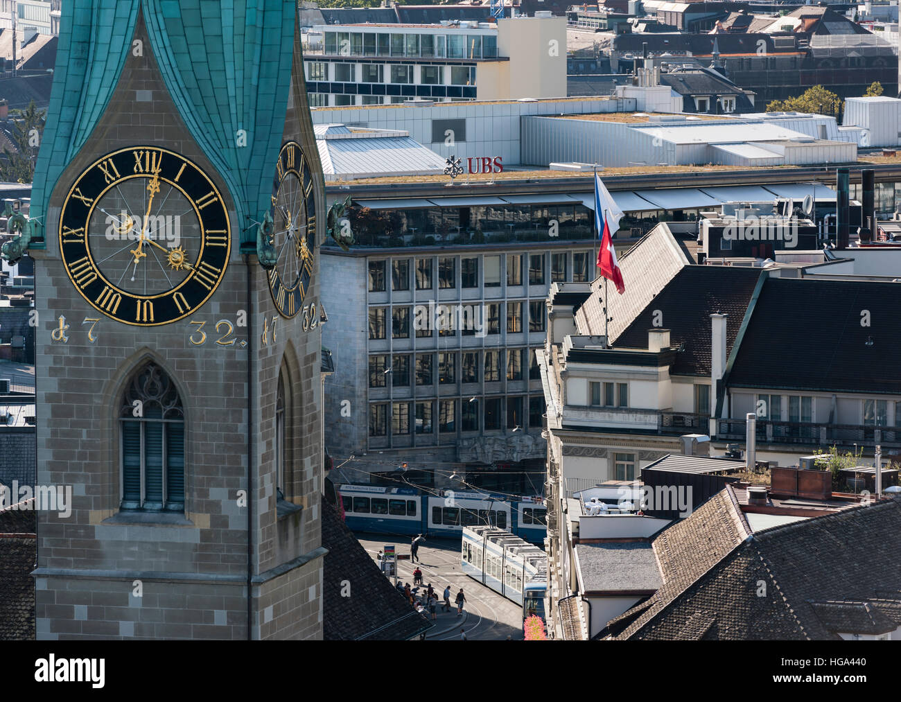 Zurich Paradeplatz with the headquarters of both UBS and Credit Suisse, visible behind the church spire of Fraumunster - Stock Image