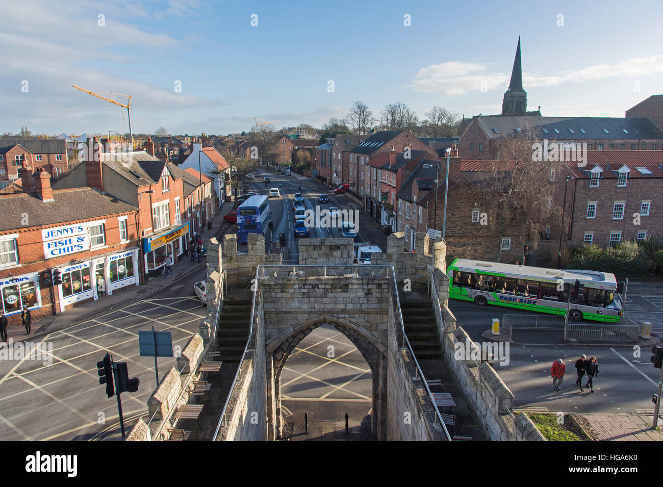 Sunny high view from top of historic Walmgate Bar, York, North Yorkshire, England, UK - crossroads junction, traffic, - Stock Image