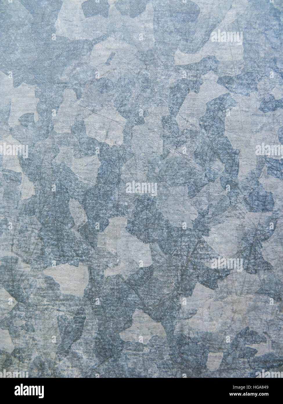 Galvanized plated metal surface background. Urban camouflage effect. - Stock Image