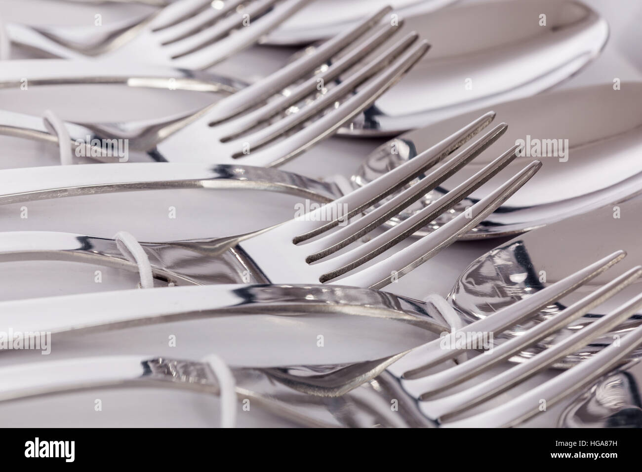 Close up macro detail of a flatware box set with forks and spoons. - Stock Image