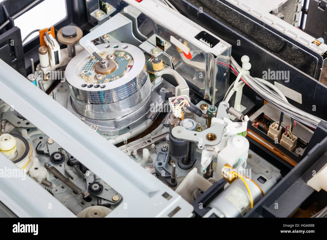Interior of the mechanics of an old and obsolete VCR or Video Cassette Recorder - Stock Image