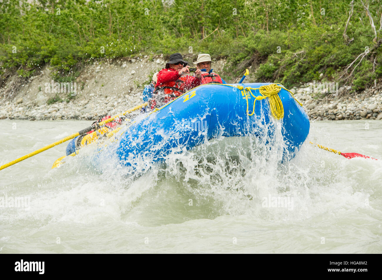 Rafters Taking Photos While Rafting Through Rapid Alsek River - Stock Image