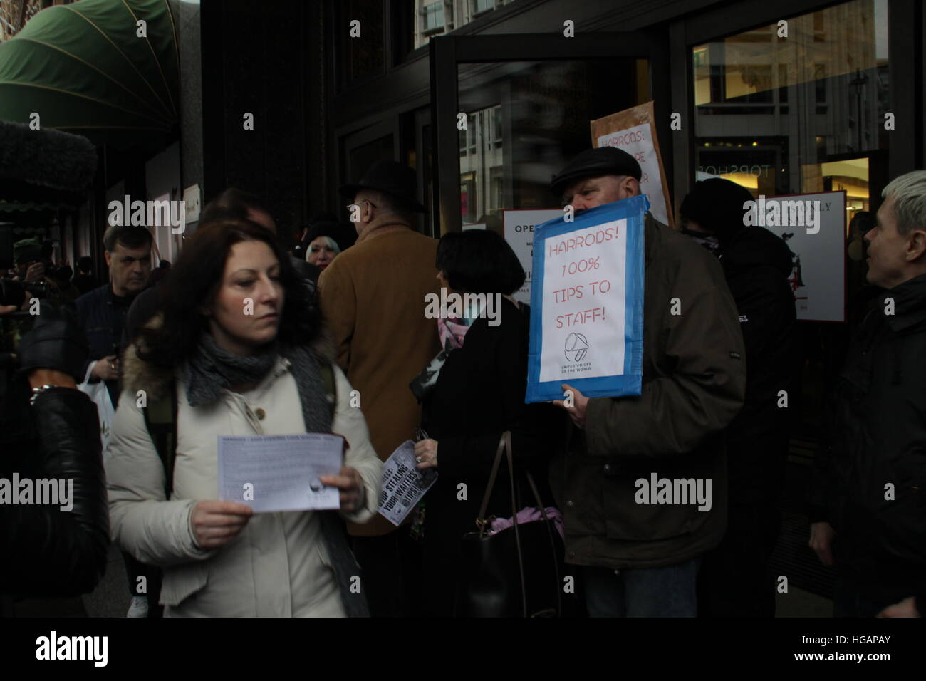 London, UK. 7th January 2017. Protesters demonstrate outside Harrods department store. The protest was organised Stock Photo