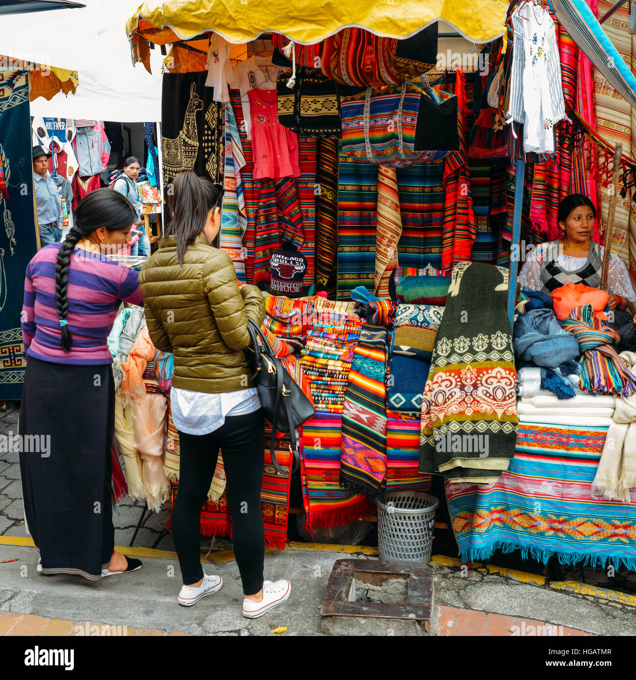 Traditional street market in Otovalo, Ecuador, full of textiles, fruit and vegetables, spices, jewerly and indigenous Stock Photo