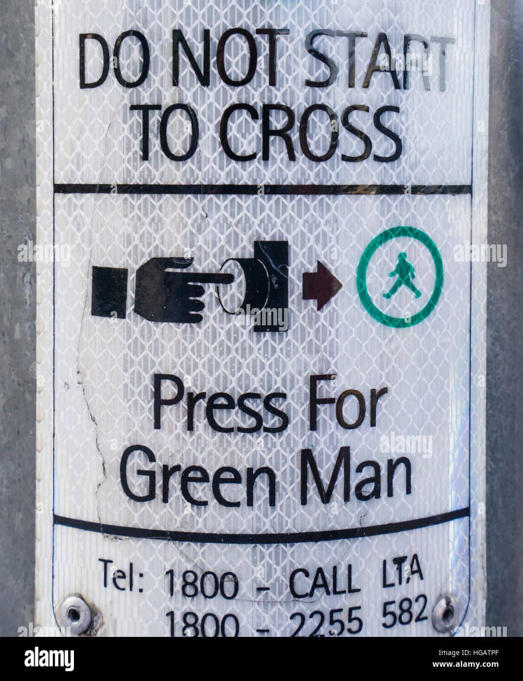 Singapore pedestrian crossing regulation: Press for Green Man - Stock Image
