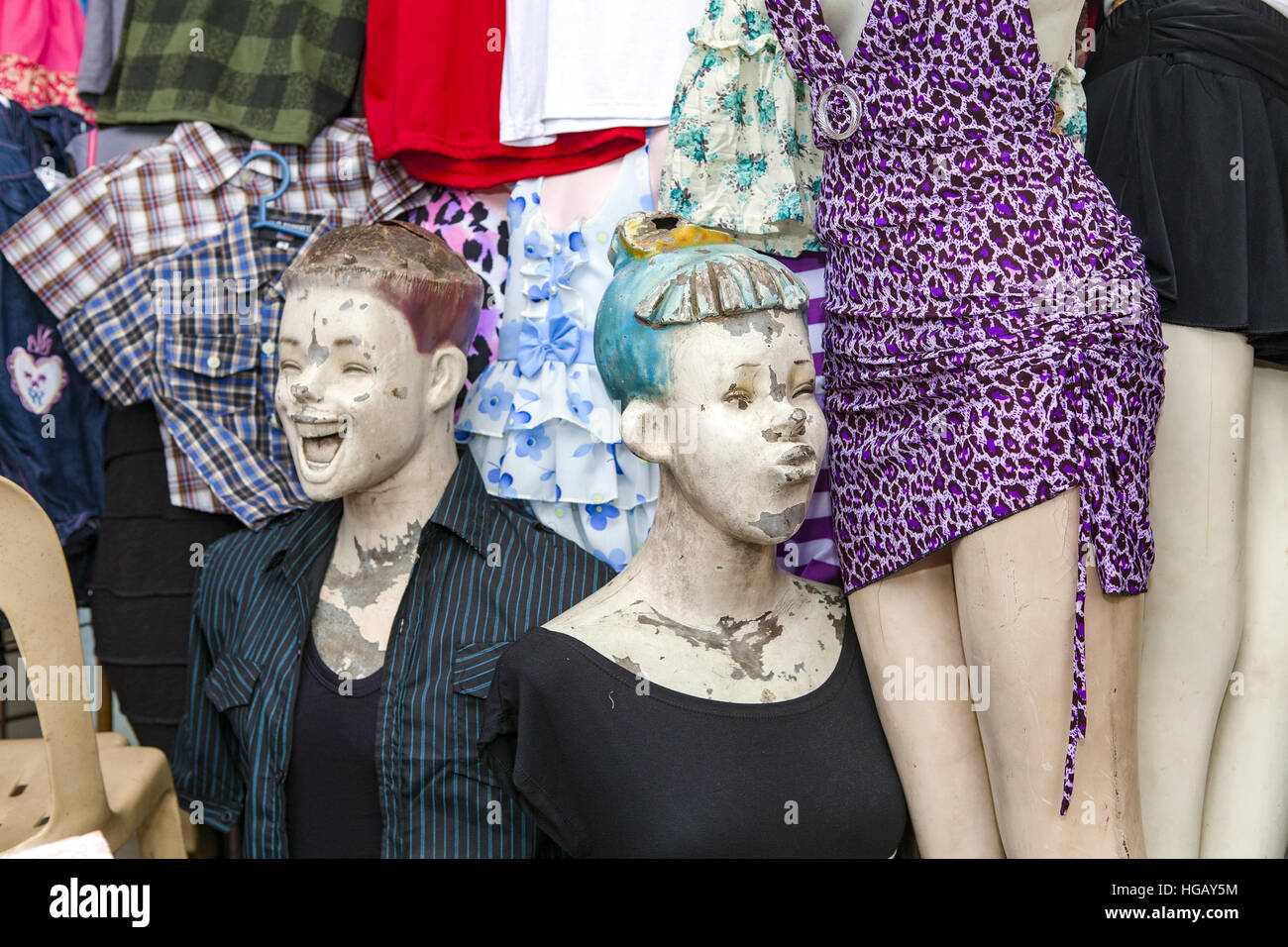 12567f6c3 Mannequins with funny expressions outside a clothing store. - Stock Image