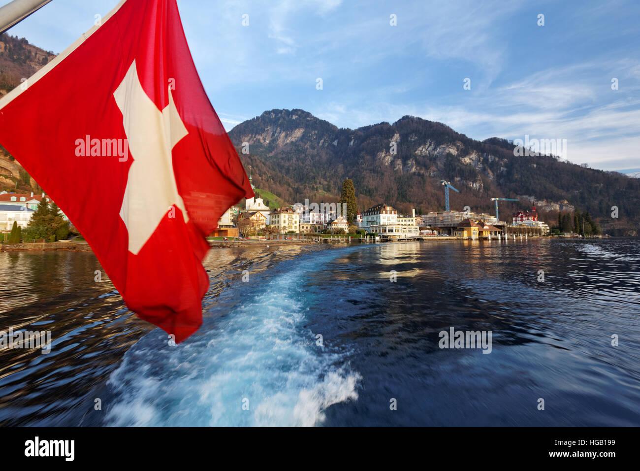Swiss flag on tour boat cruising Lake Lucerne, Vitznau, Switzerland - Stock Image
