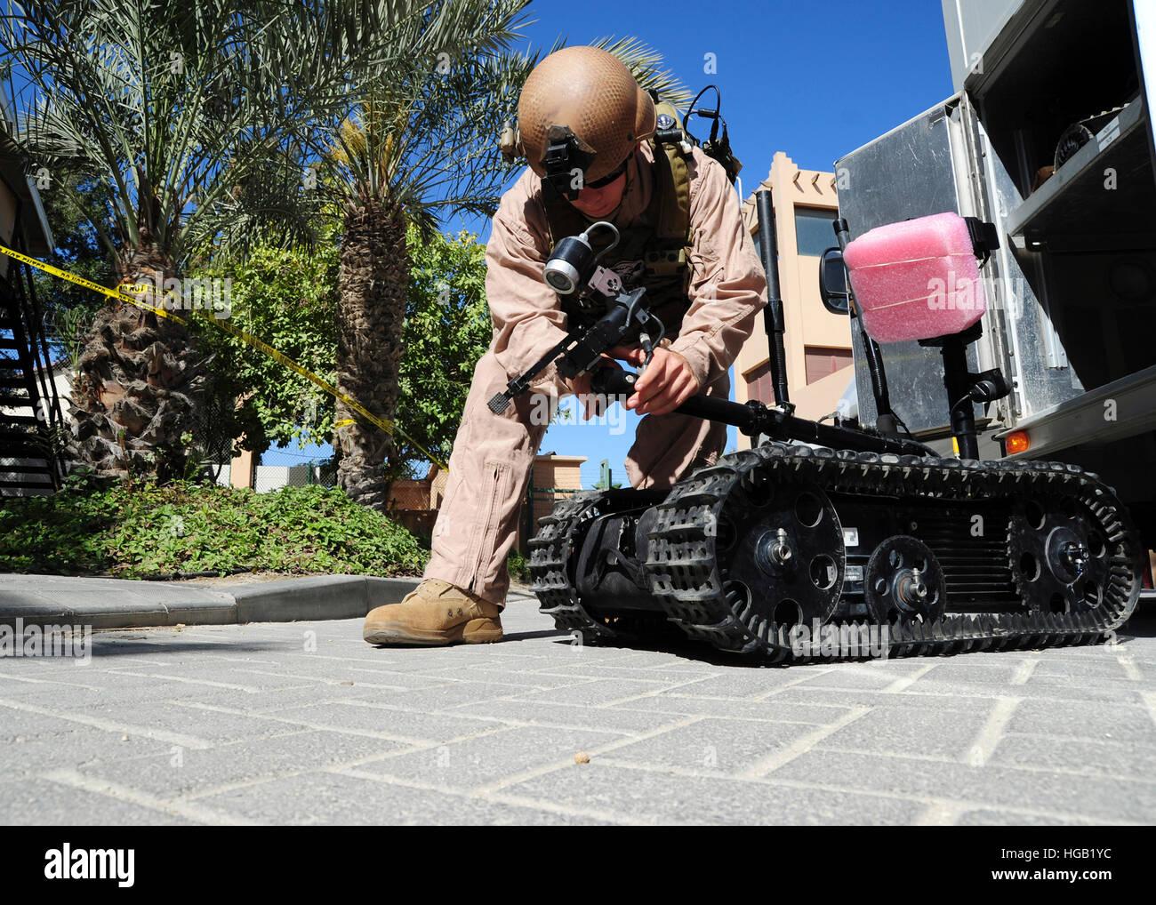 Explosive Ordnance Disposal Technician prepares a Talon remote-controlled robot. - Stock Image