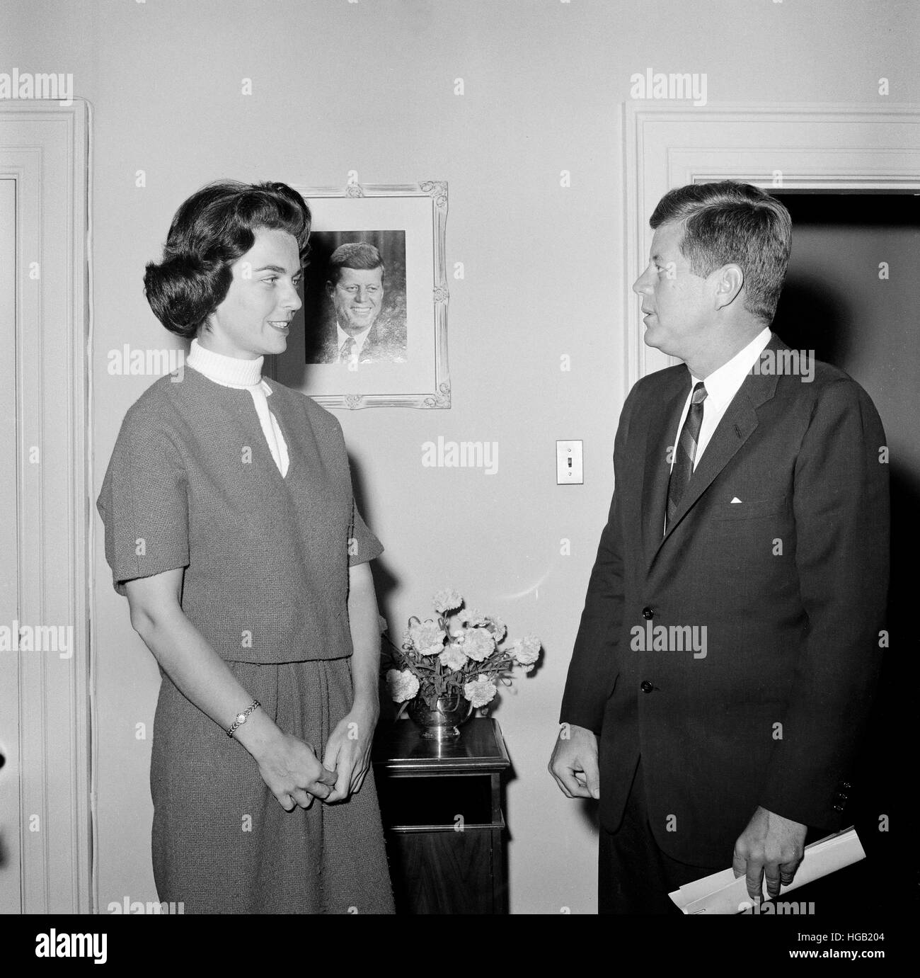 President John F. Kennedy with a former White House staff member. - Stock Image