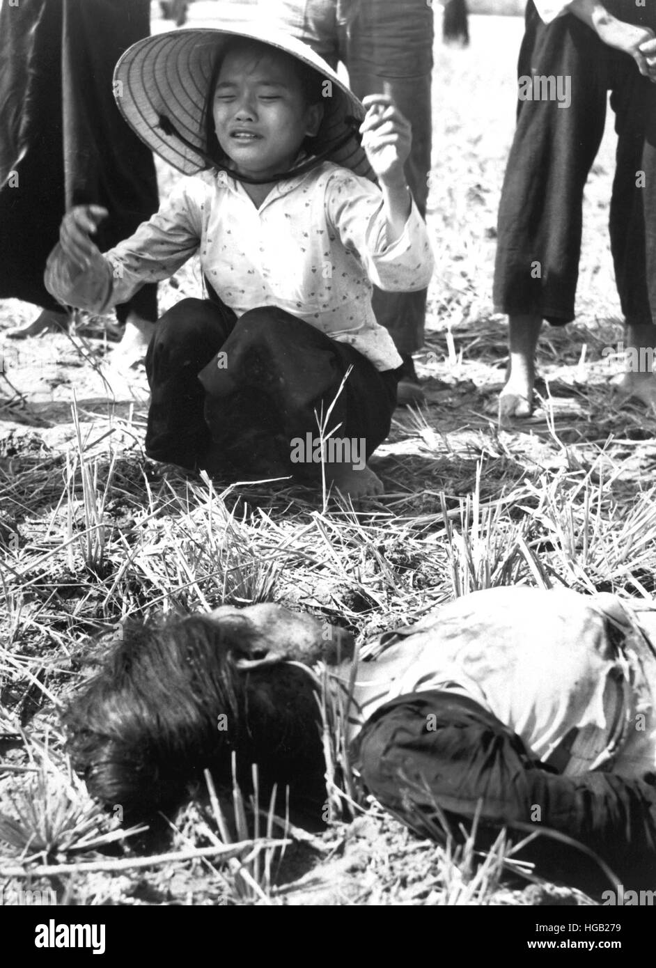 A civilian grieves over friend killed by a Viet Cong mine in Vietnam, 1966. - Stock Image