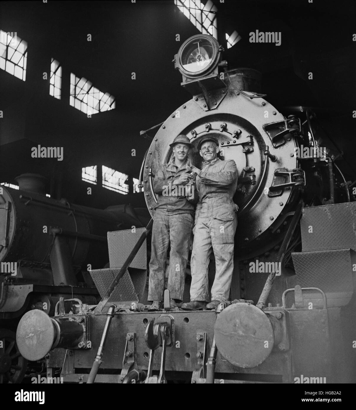 American and British engineers standing on an American engine in Iran, 1943. - Stock Image