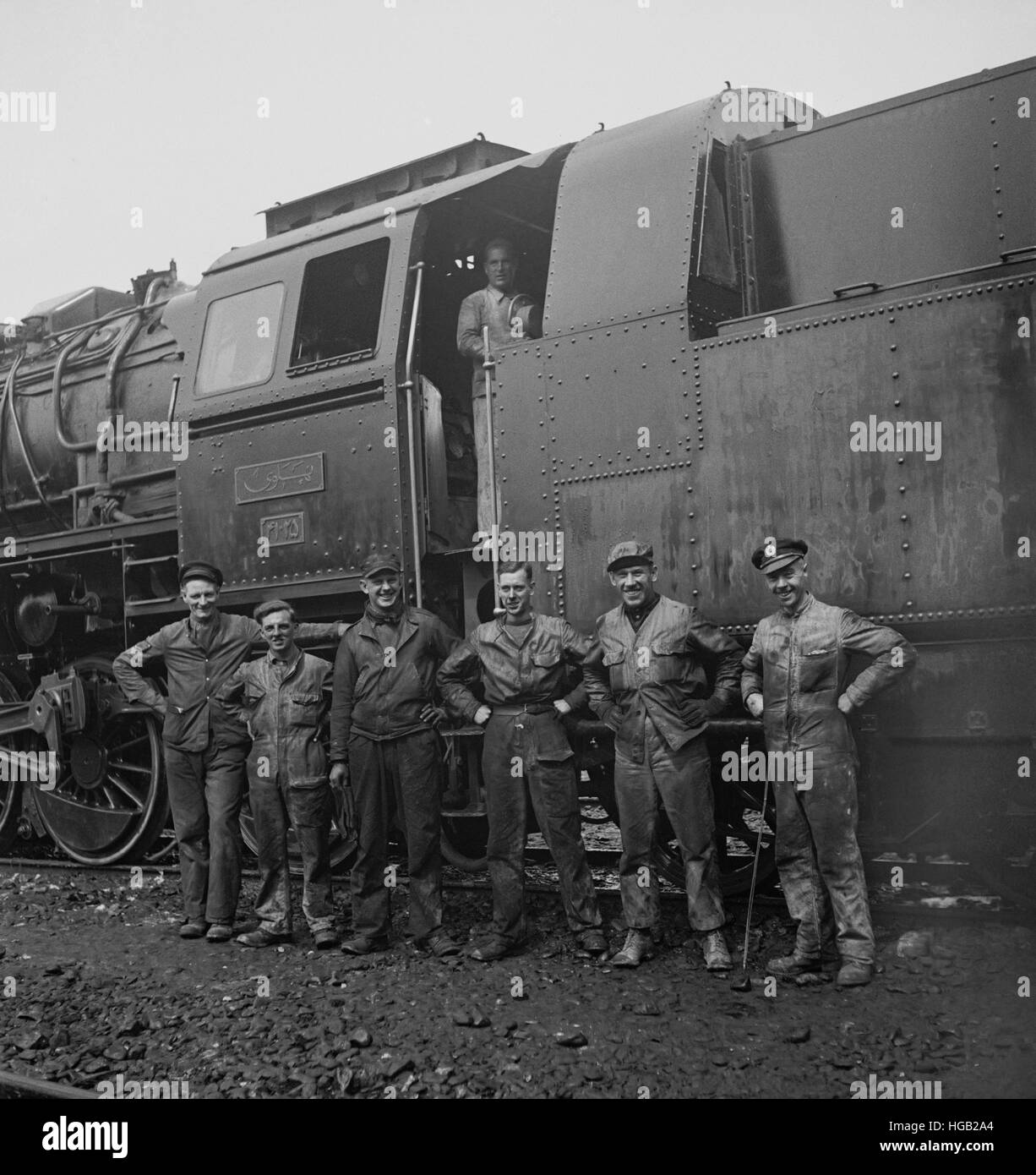 American and British railroad crews who are taking supplies for Russia, 1943. - Stock Image