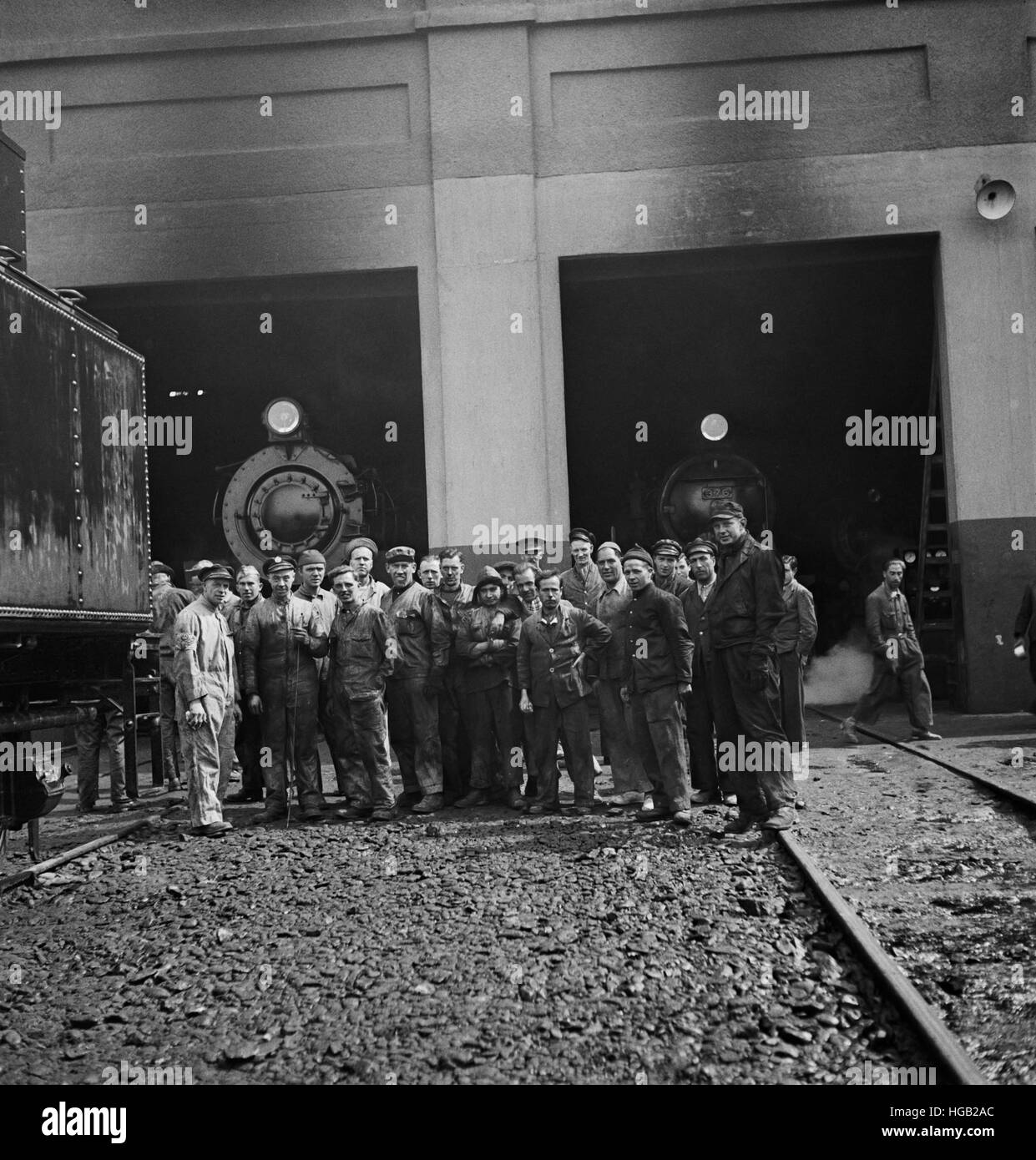 American and British railroad workers at a roundhouse somewhere in Iran, 1943. - Stock Image