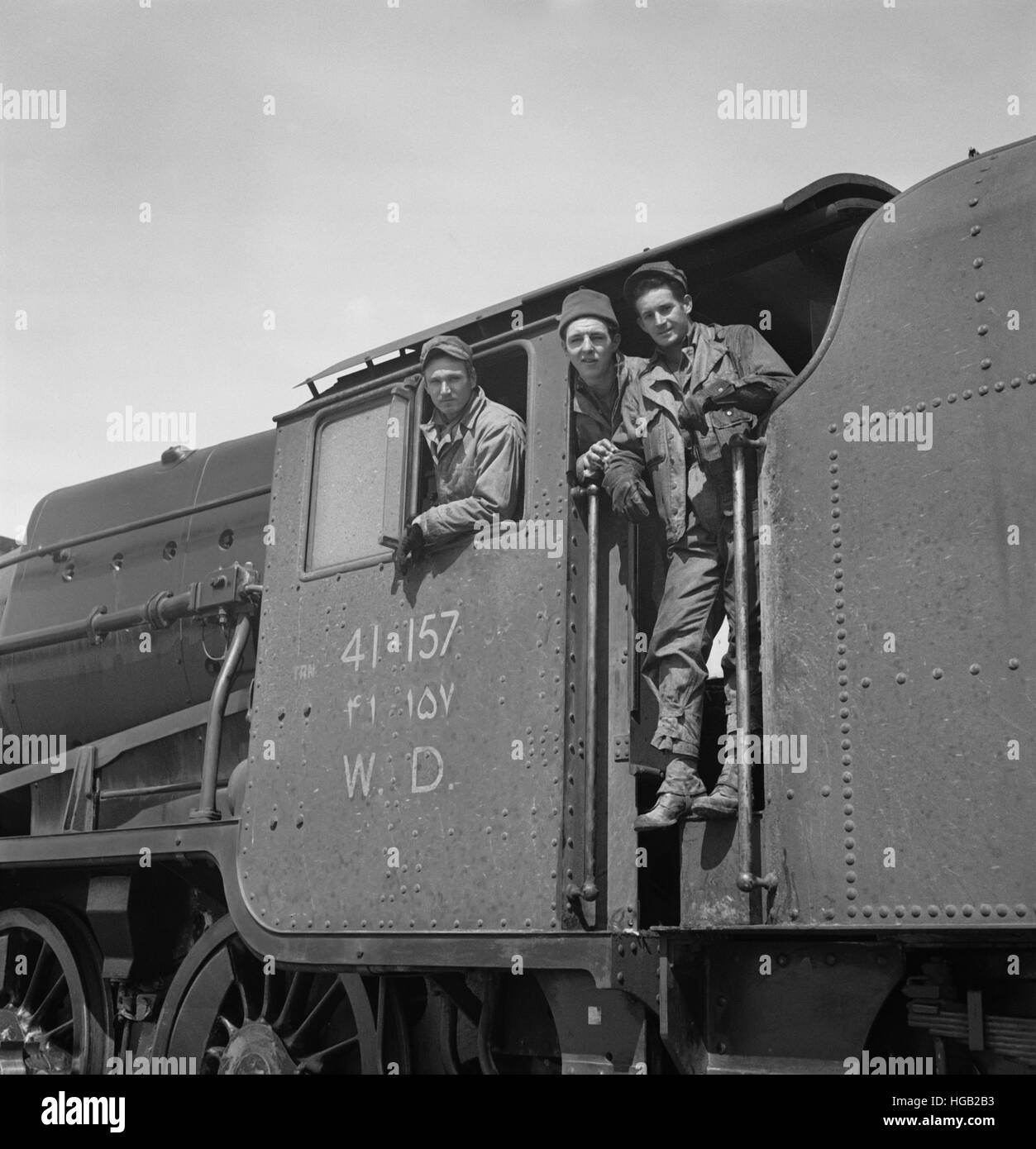 Mixed crew of American and British engineers in the cab of an American engine, 1943. - Stock Image