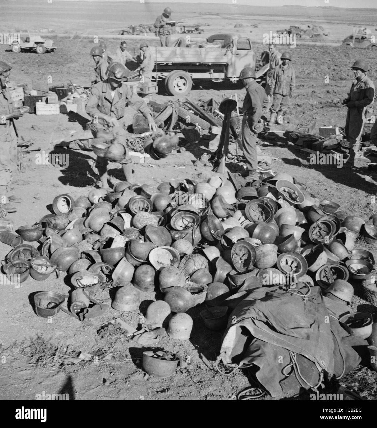 Pile of German helmets left by the Tenth and Fifteenth Panzer Divisions, 1943. - Stock Image