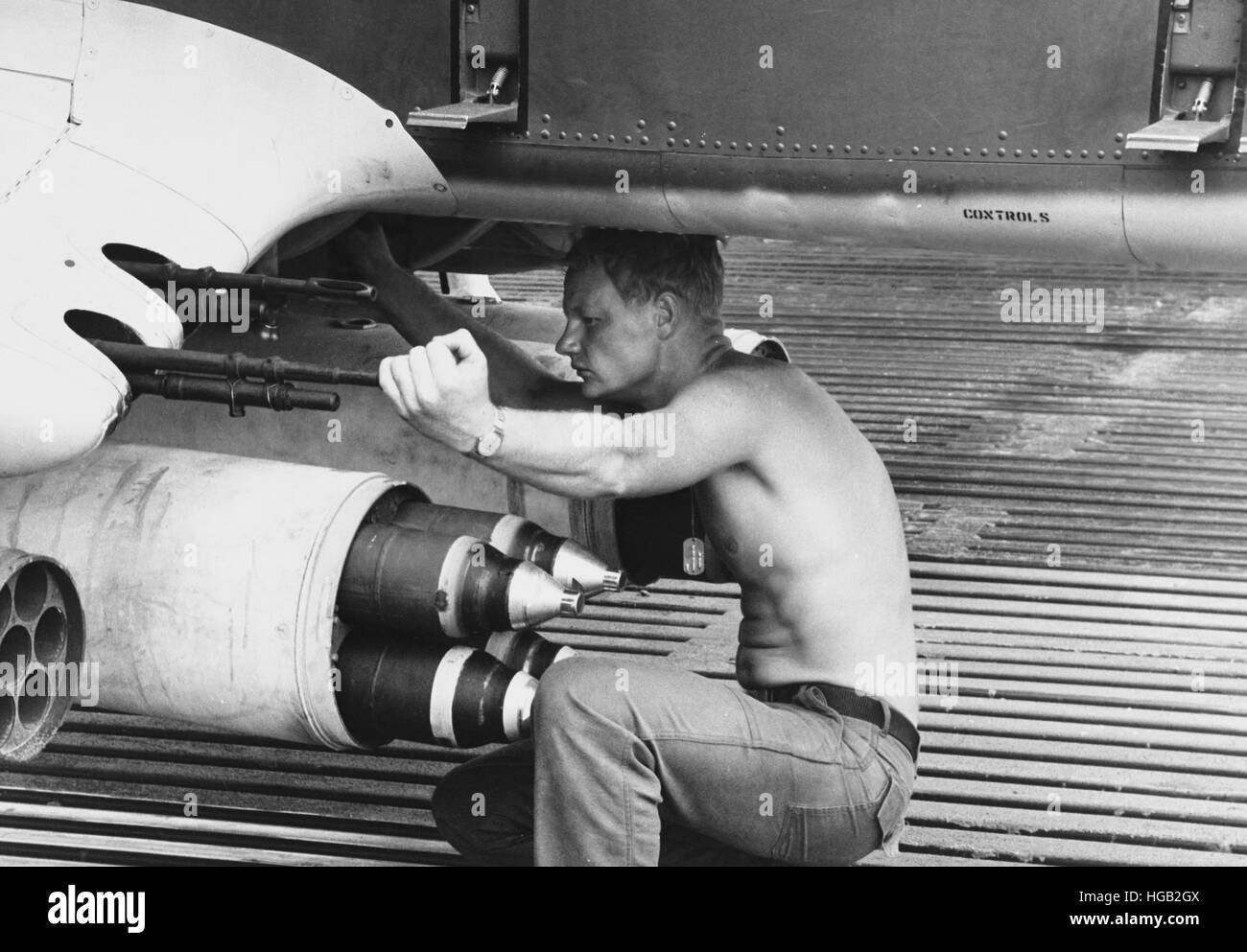 Aviation Machinist Mate drains a fuel sample from an OV-10A Bronco plane in Vietnam, 1969. - Stock Image
