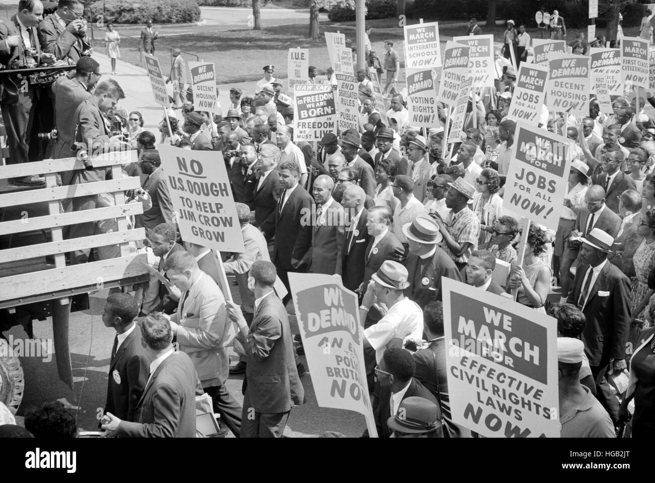 Civil rights leaders surrounded by crowds carrying signs, Washington D.C. - Stock Image