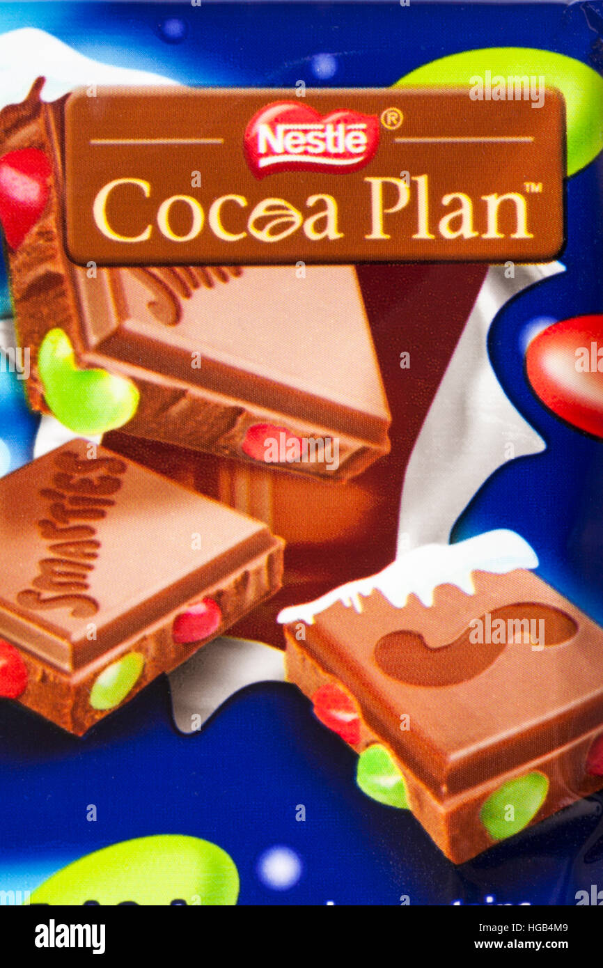 Nestle Cocoa Plan - detail on bar of Nestle Smarties Festive Sharing Block of chocolate - Stock Image