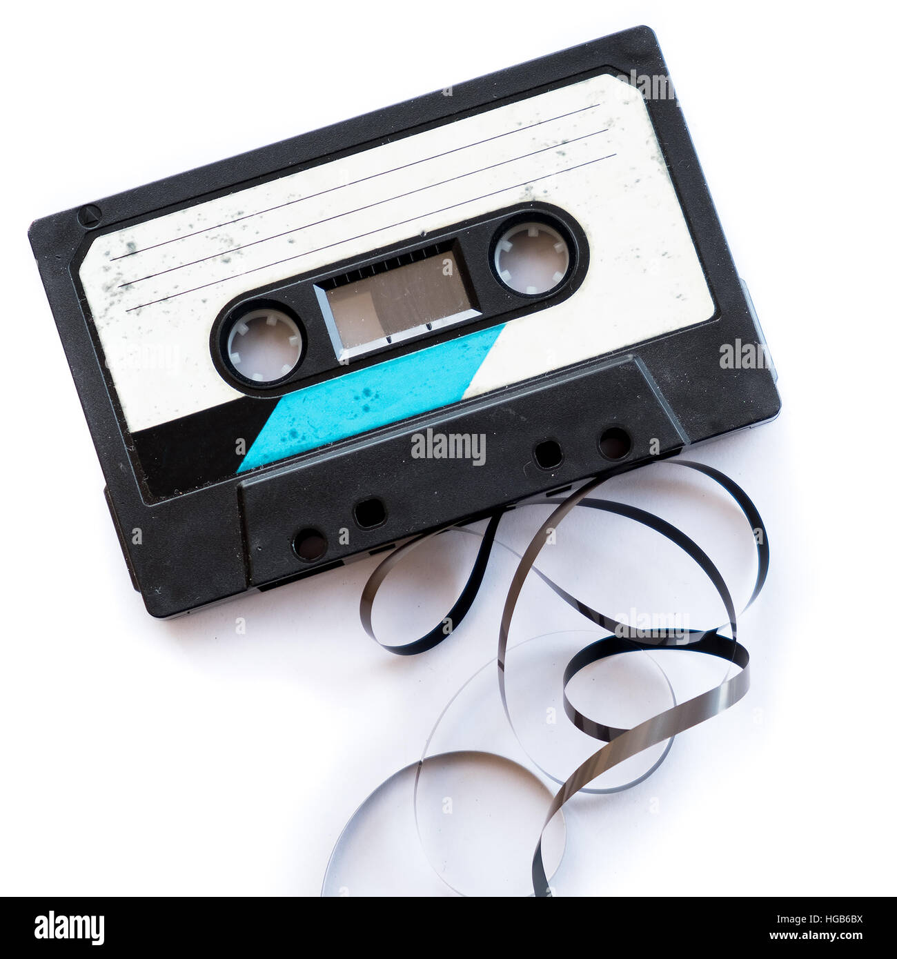 audio tape blank label rolled out isolated white playlist - Stock Image