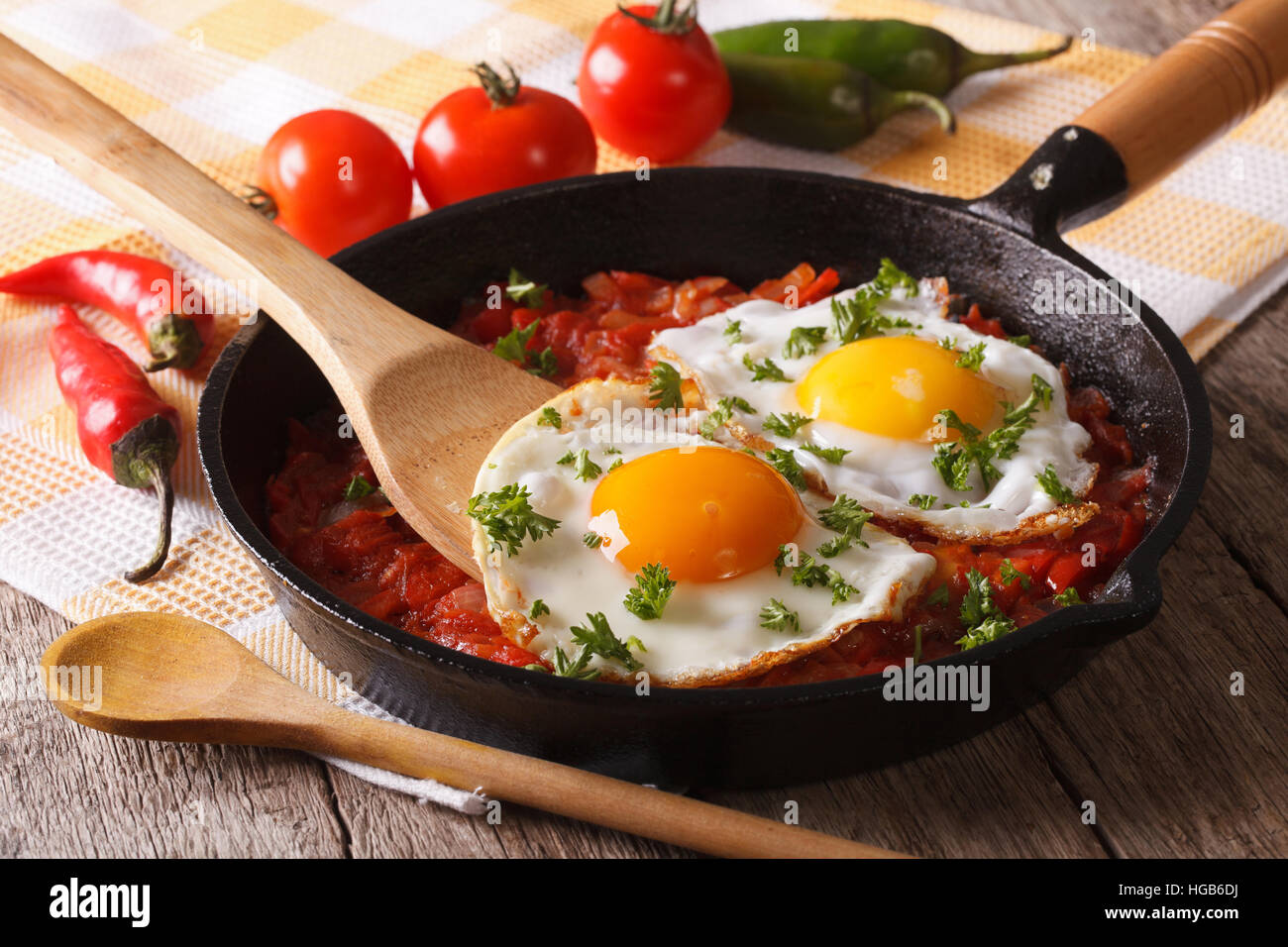 Traditional Mexican breakfast fried egg with salsa closeup in the pan. Horizontal - Stock Image