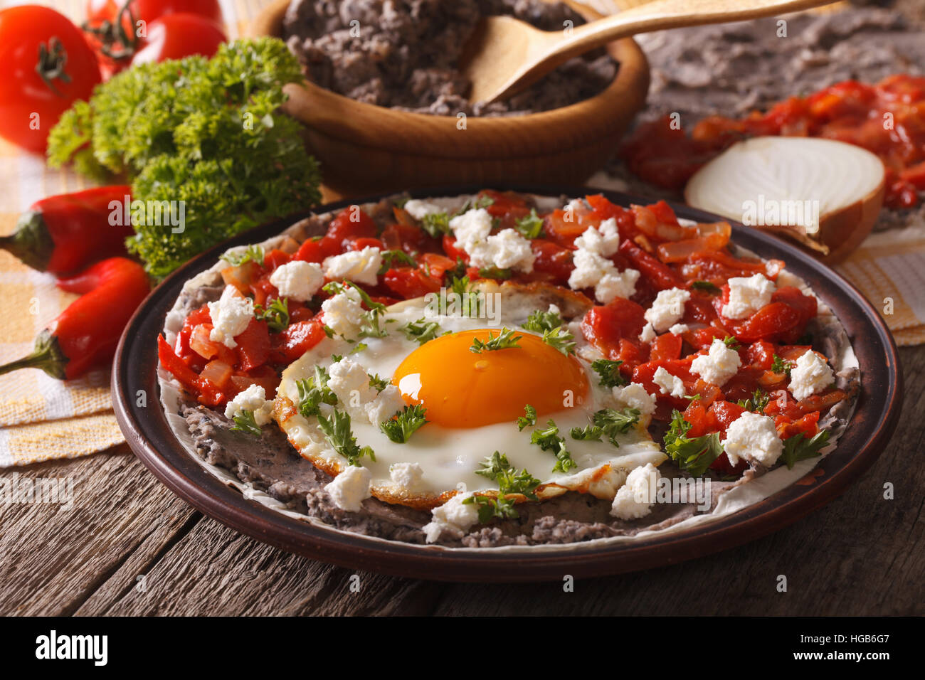 Mexican food: huevos rancheros close-up on a plate on the table. Horizontal - Stock Image
