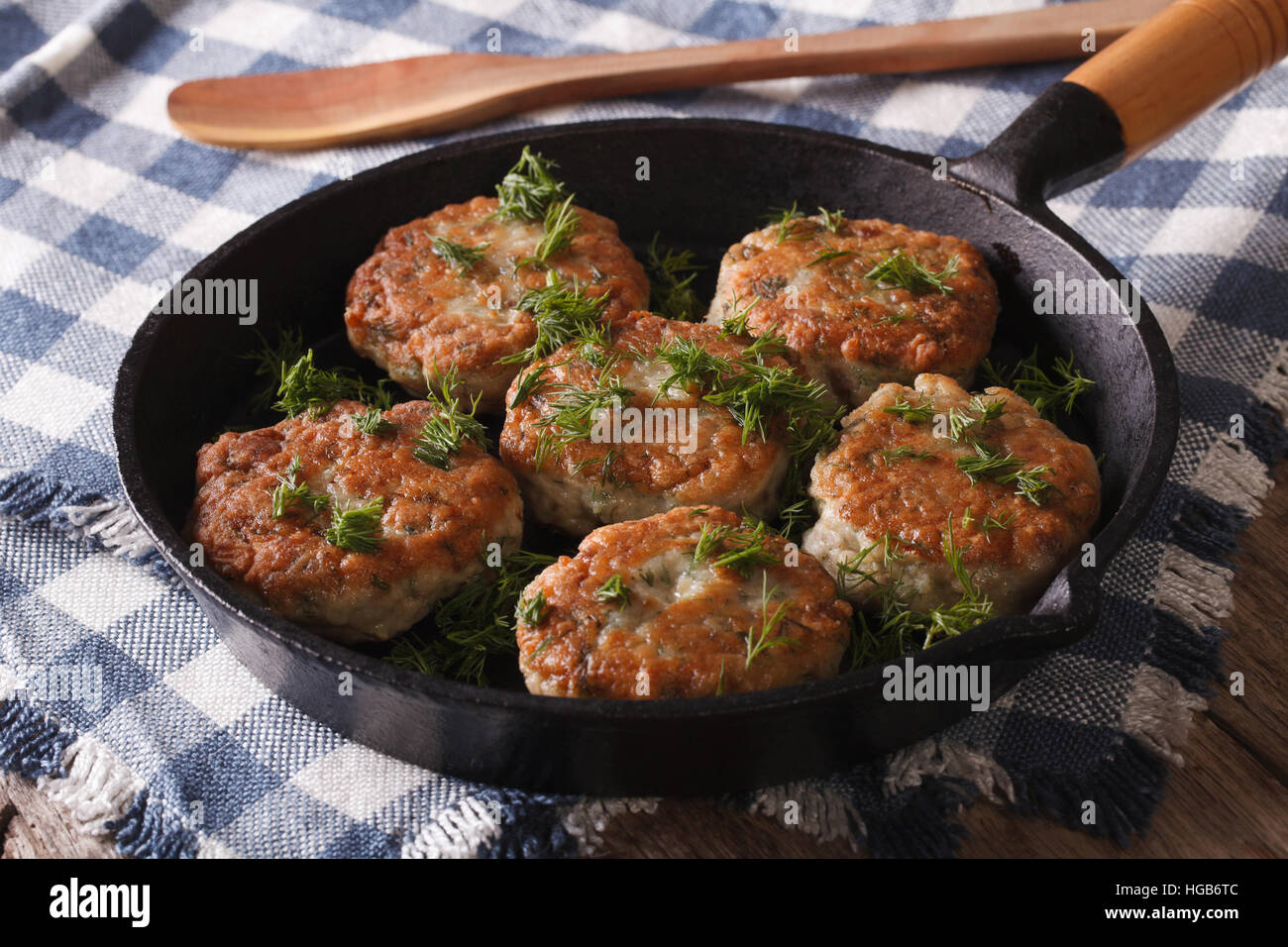 fishcakes with herbs close-up in a pan on the table. Horizontal - Stock Image