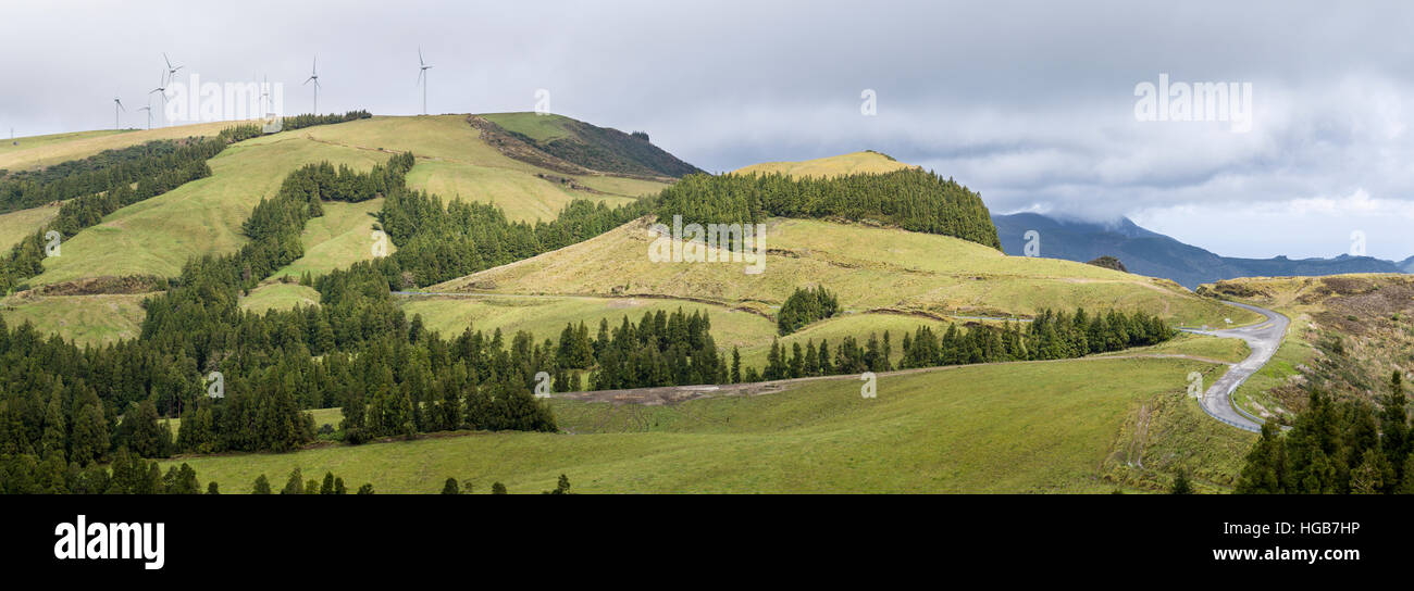 Wind Turbines on the Crater's Edge. A cluster of wind turbines generates power along the edge of the Furnas - Stock Image