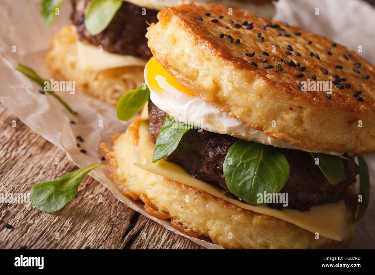 The popular ramen burger macro on a paper on the wooden table. horizontal - Stock Image