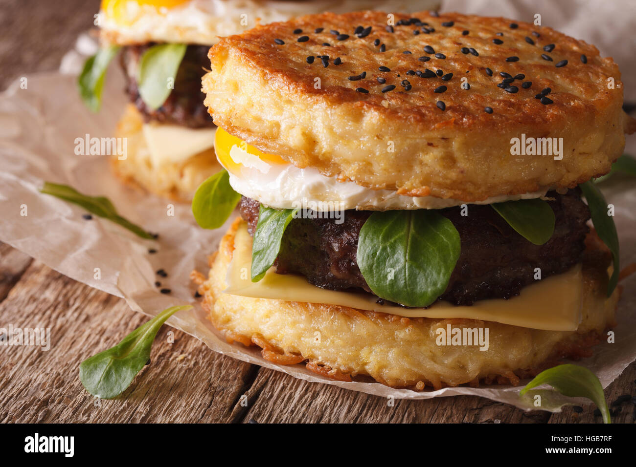 Hot ramen burger macro on a paper on a wooden table. horizontal - Stock Image