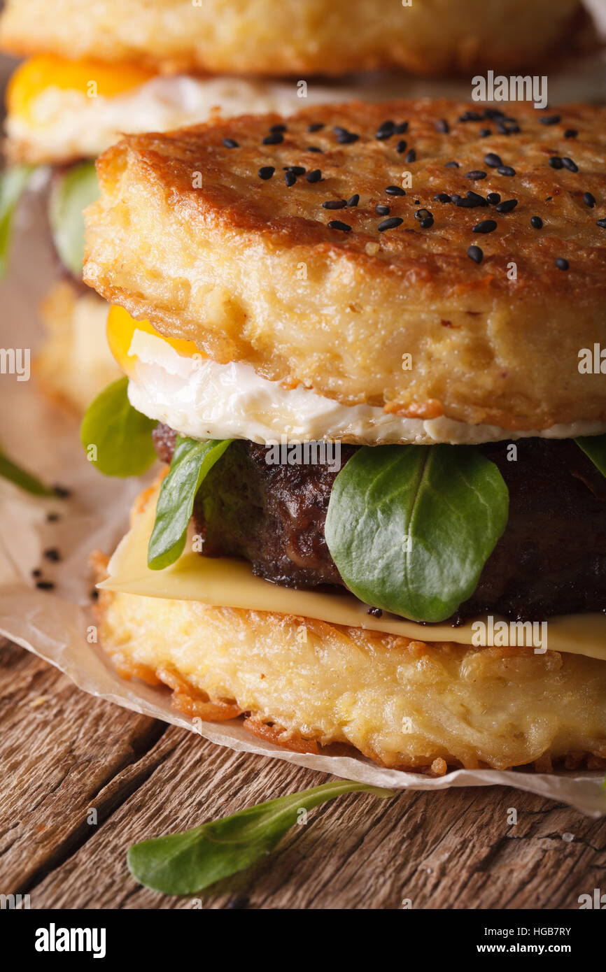 Juicy ramen burger with egg close up on the table. Vertical - Stock Image