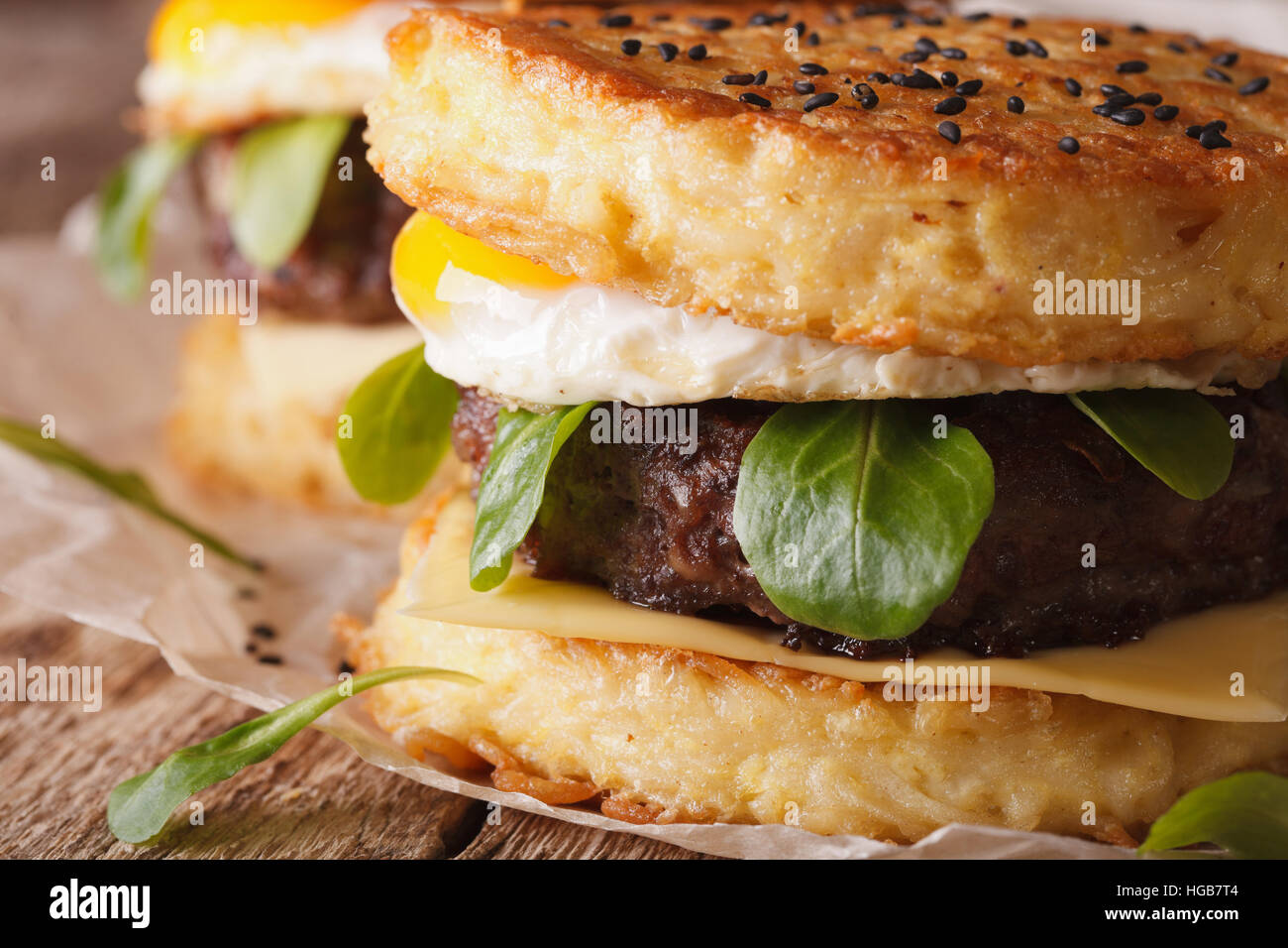 Juicy ramen burger with egg close up on the table. horizontal - Stock Image