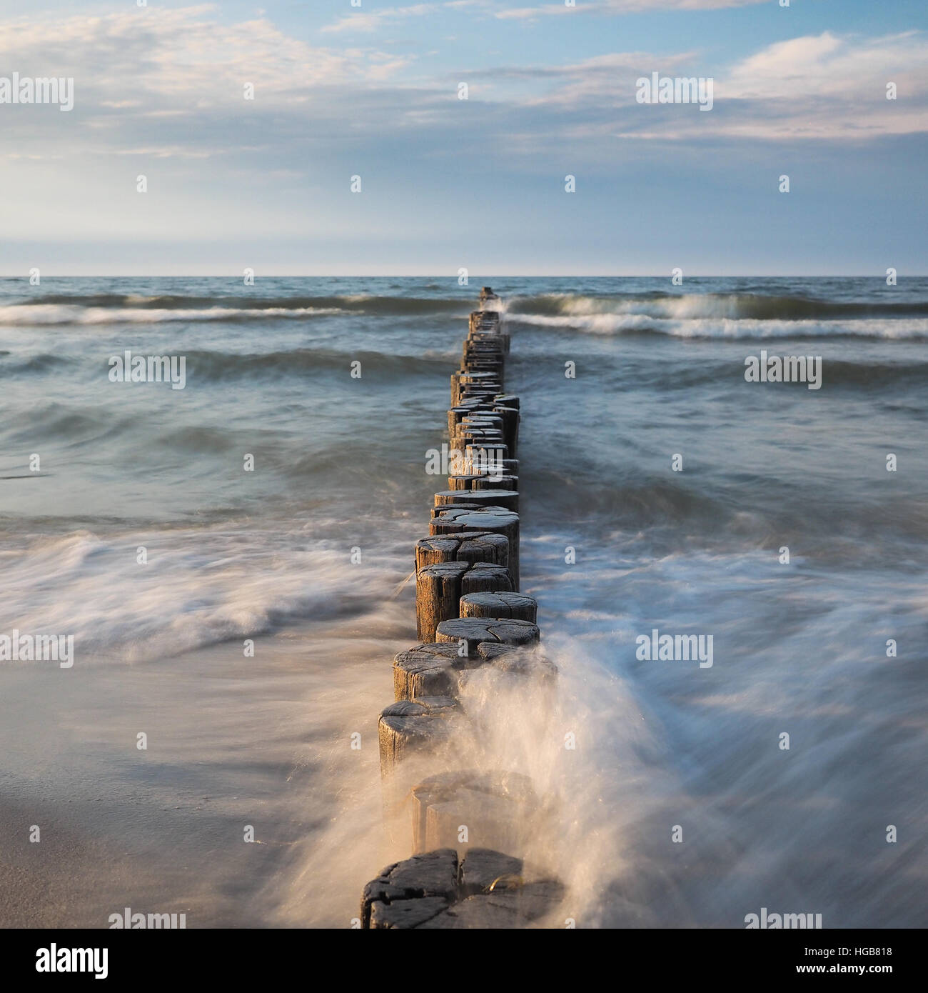 Baltic Sea with breakwaters at daylight - Stock Image