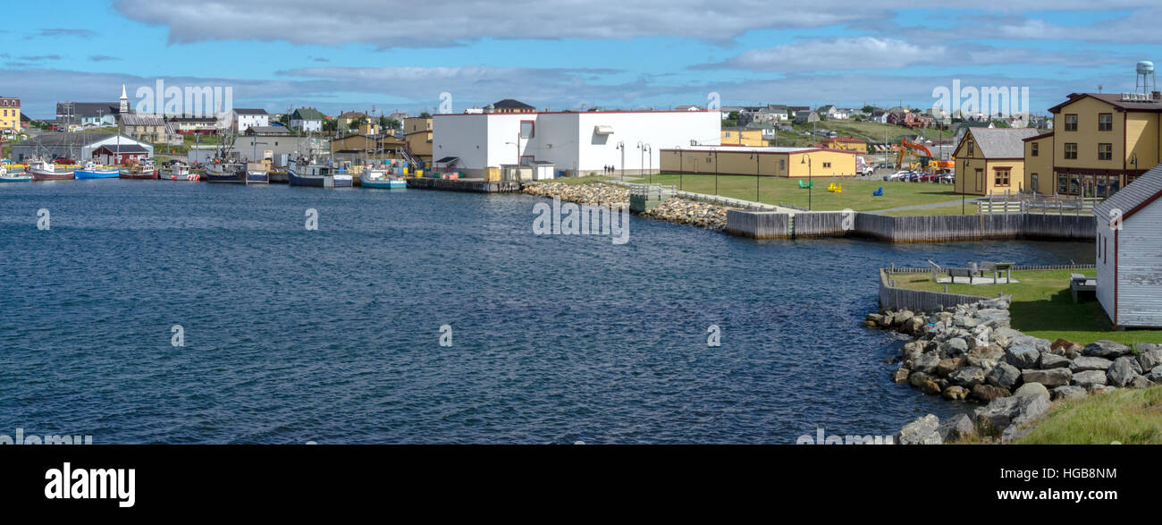 Working day in Bonavista village.  Shoreline View across the water to town in rural Newfoundland, Canada. - Stock Image