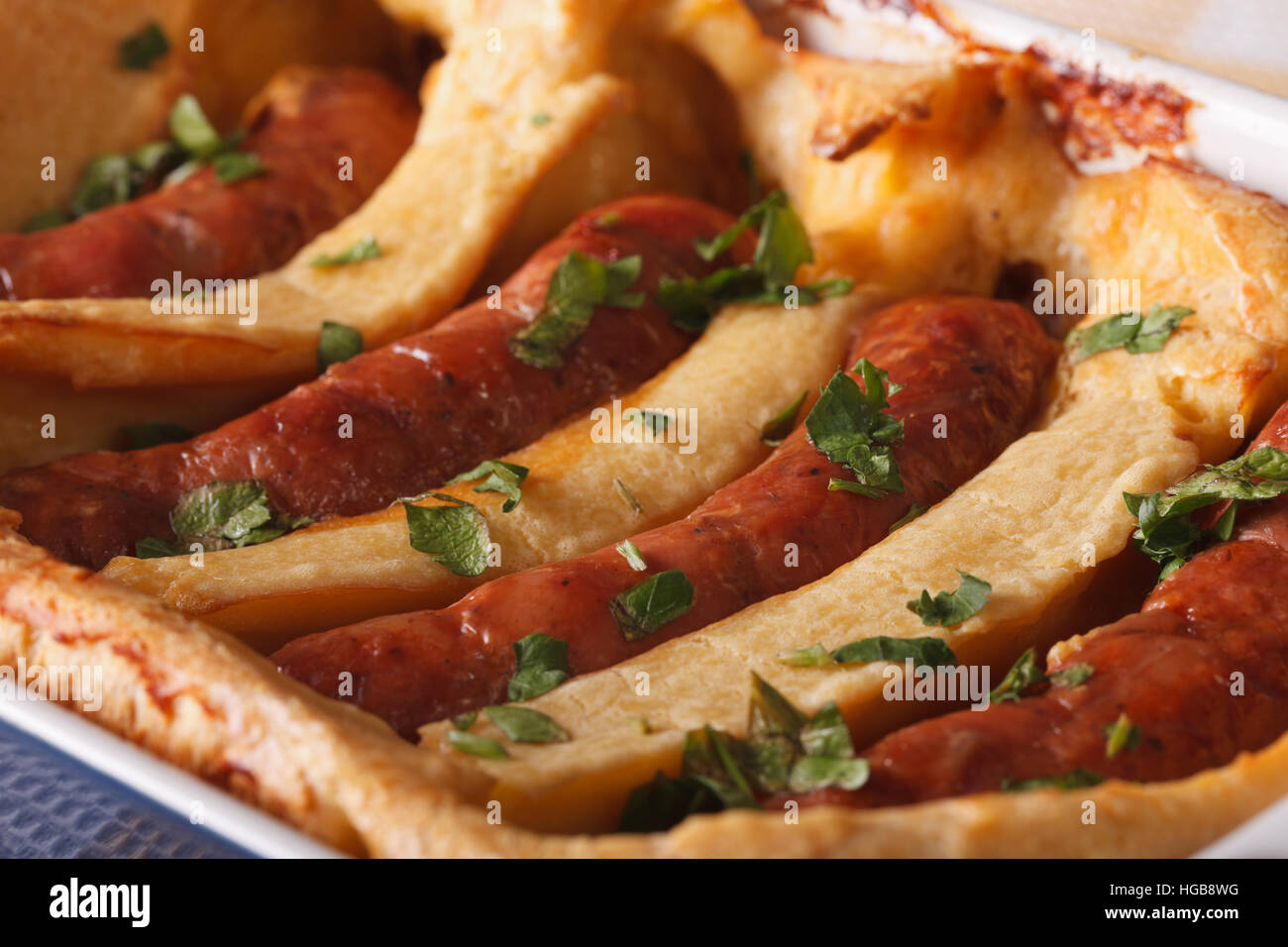 Traditional English dish toad in the hole macro horizontal - Stock Image