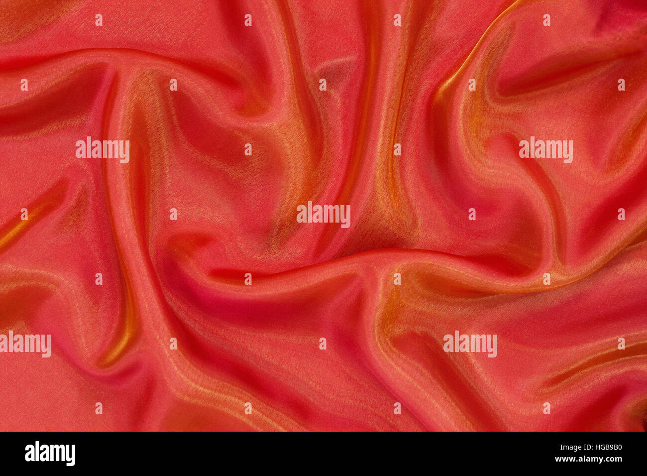 background drape orange organza (view from above) - Stock Image