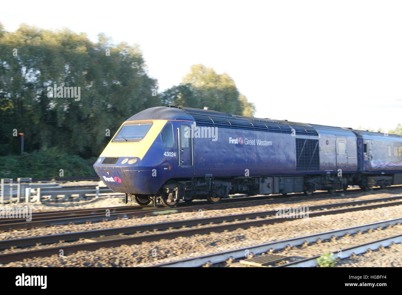 HST locomotive No.43024 departs Platform 3 of Swindon station in October 2016 branded in First Great Western livery. Stock Photo