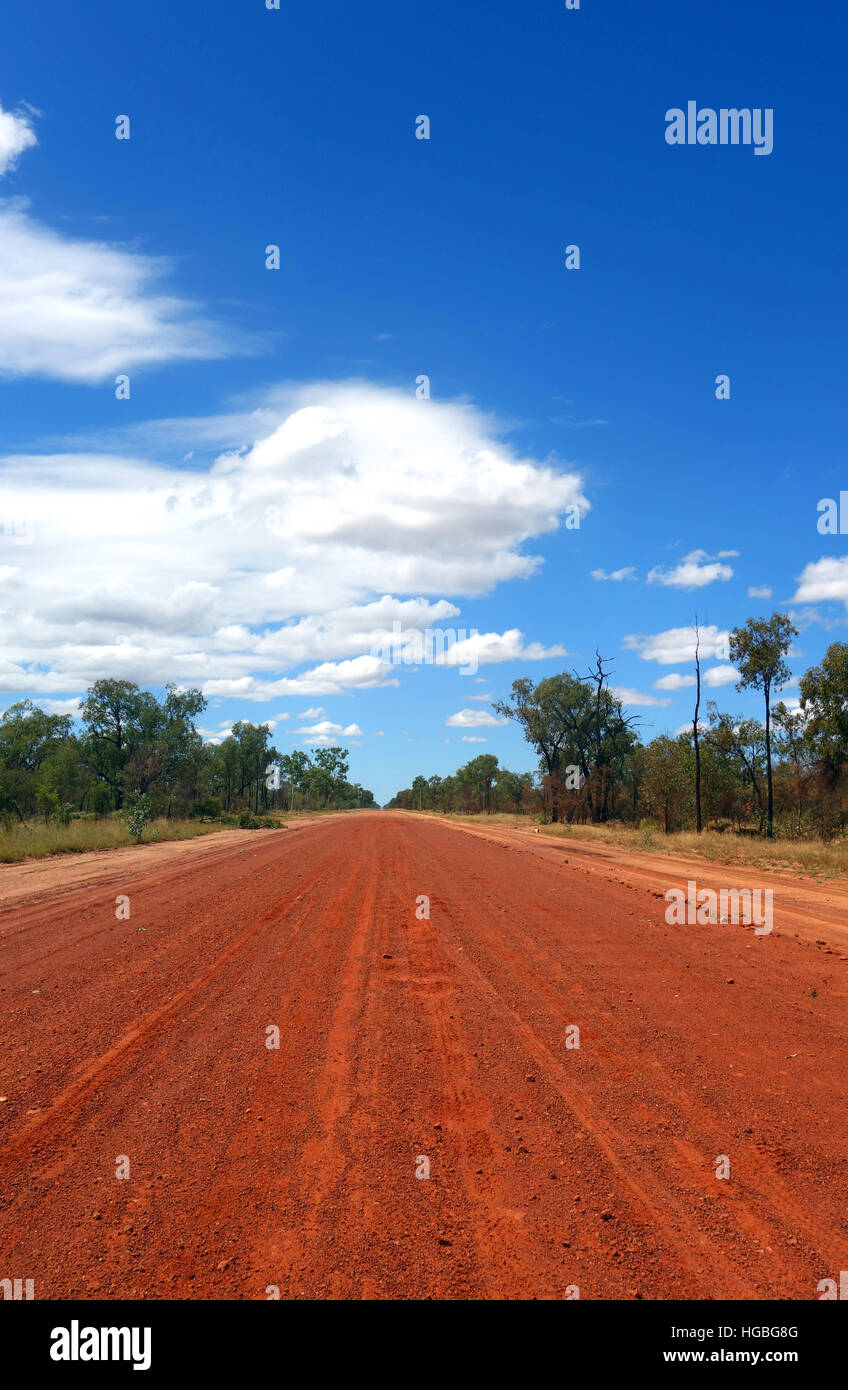 Straight, corrugated red dirt outback road, north of Barcaldine, Queensland, Australia - Stock Image