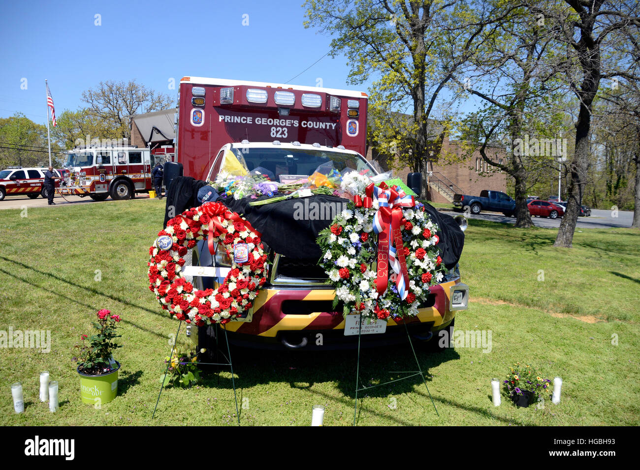 flowers cover an ambulance where the EMT's were shot and one killed on a medic call - Stock Image