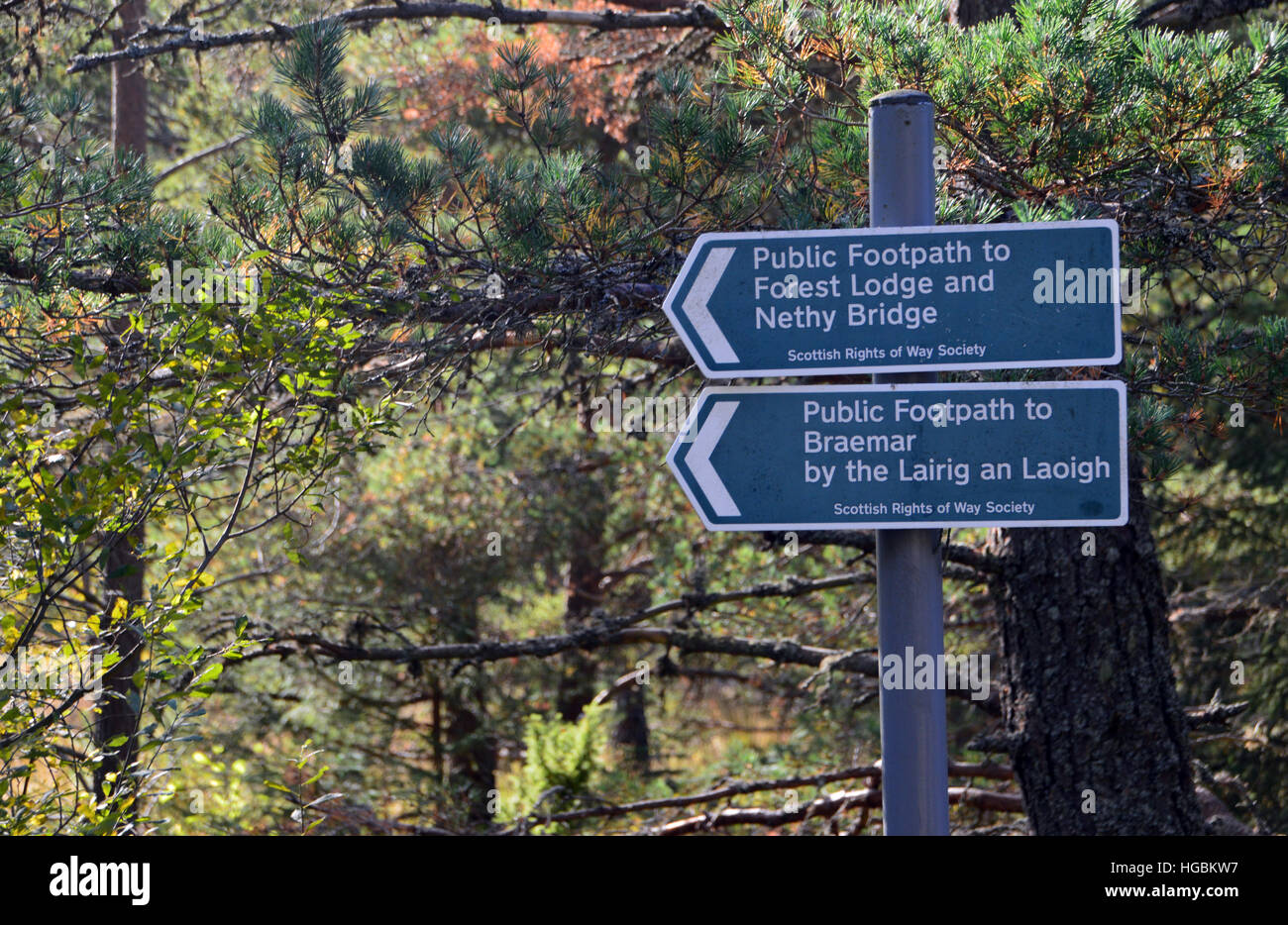 Metal Public Footpath Signpost to Forest Lodge & Nethy Bridge and Braemar & the Lairig an Laoigh from Glenmore Lodge. Stock Photo