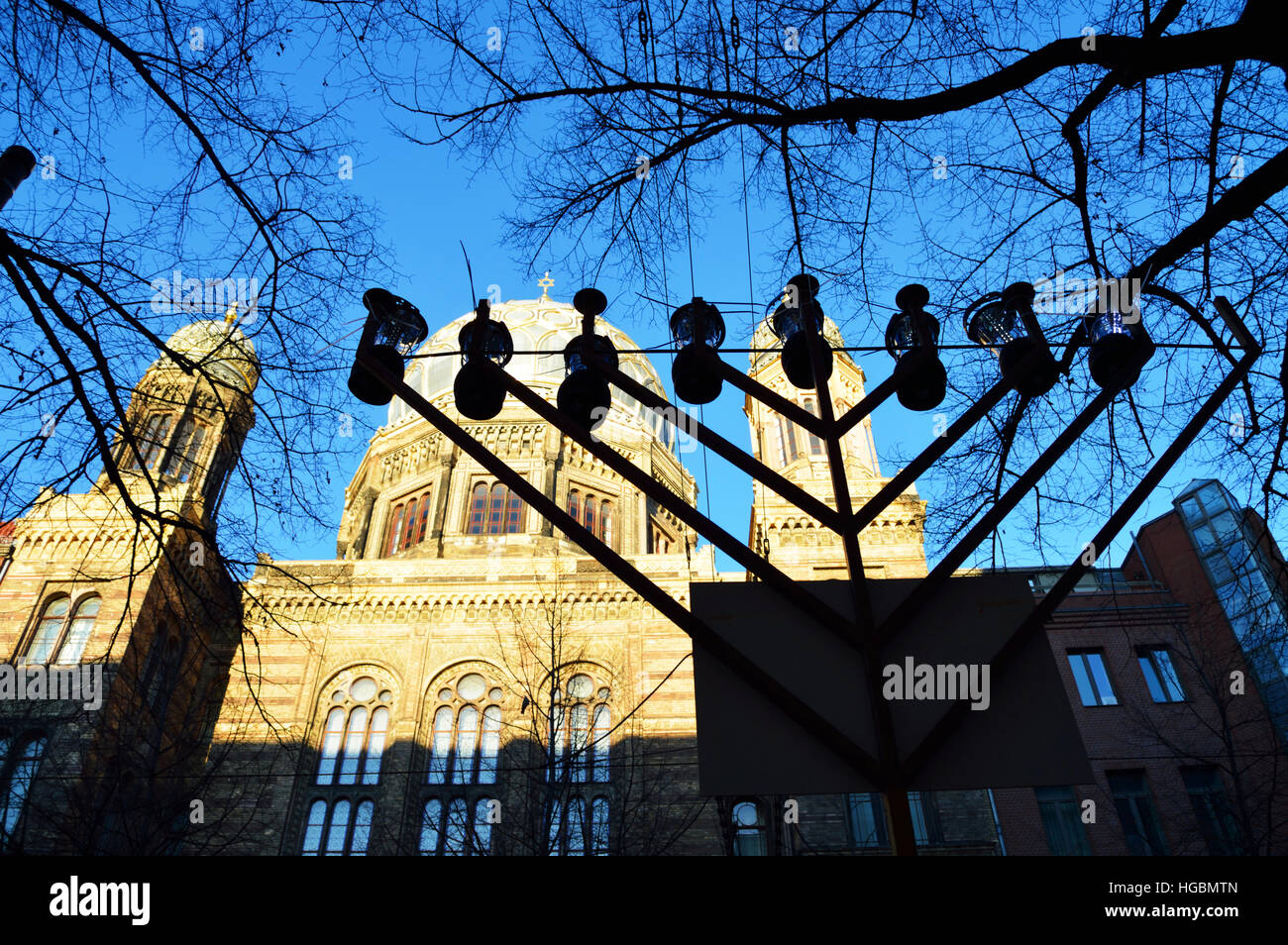 A hanukkah menorah in front of the New Synagogue (Neue Synagoge) in Berlin, Germany - Stock Image