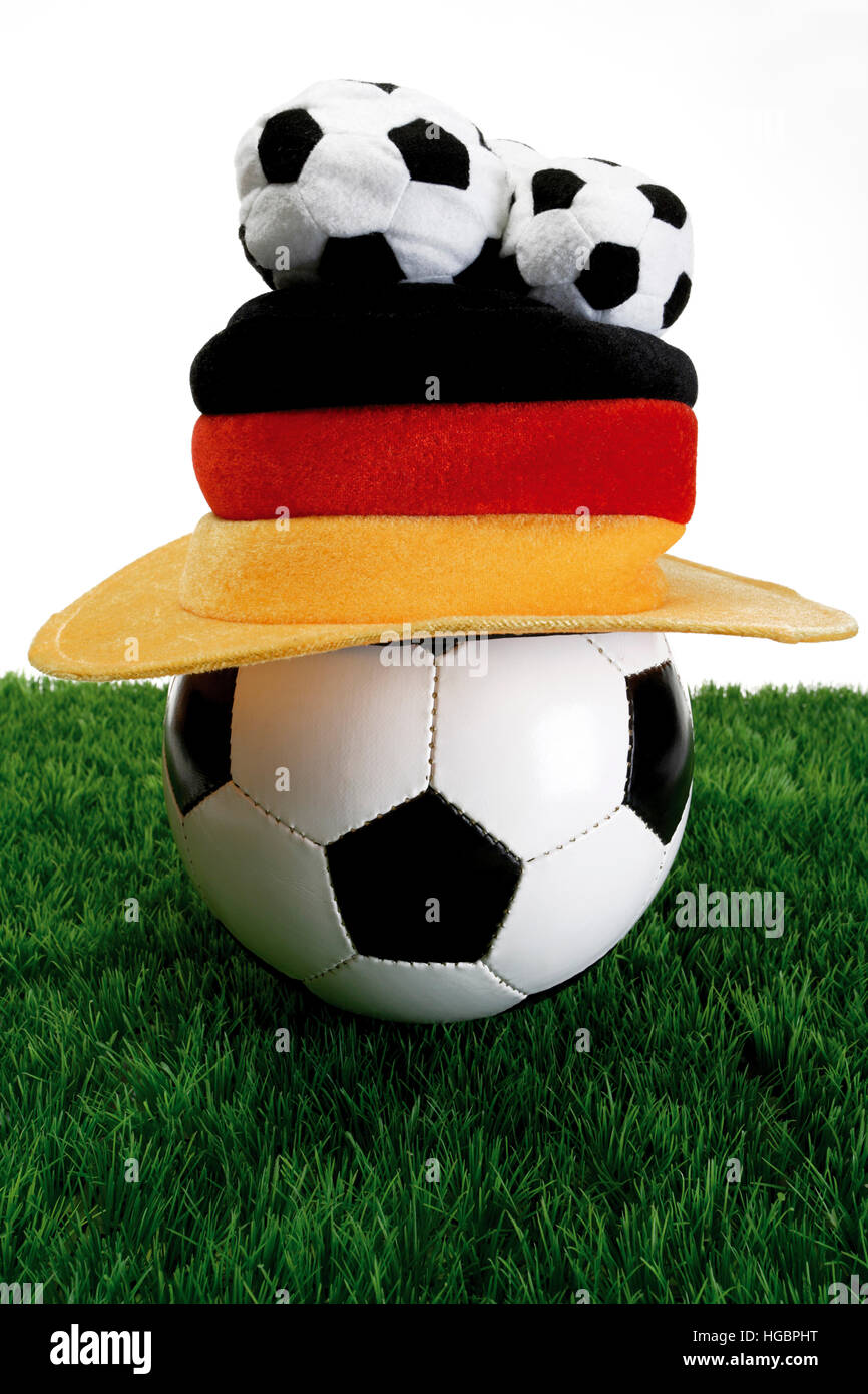 Football with Germany fan hat laying on grass Stock Photo